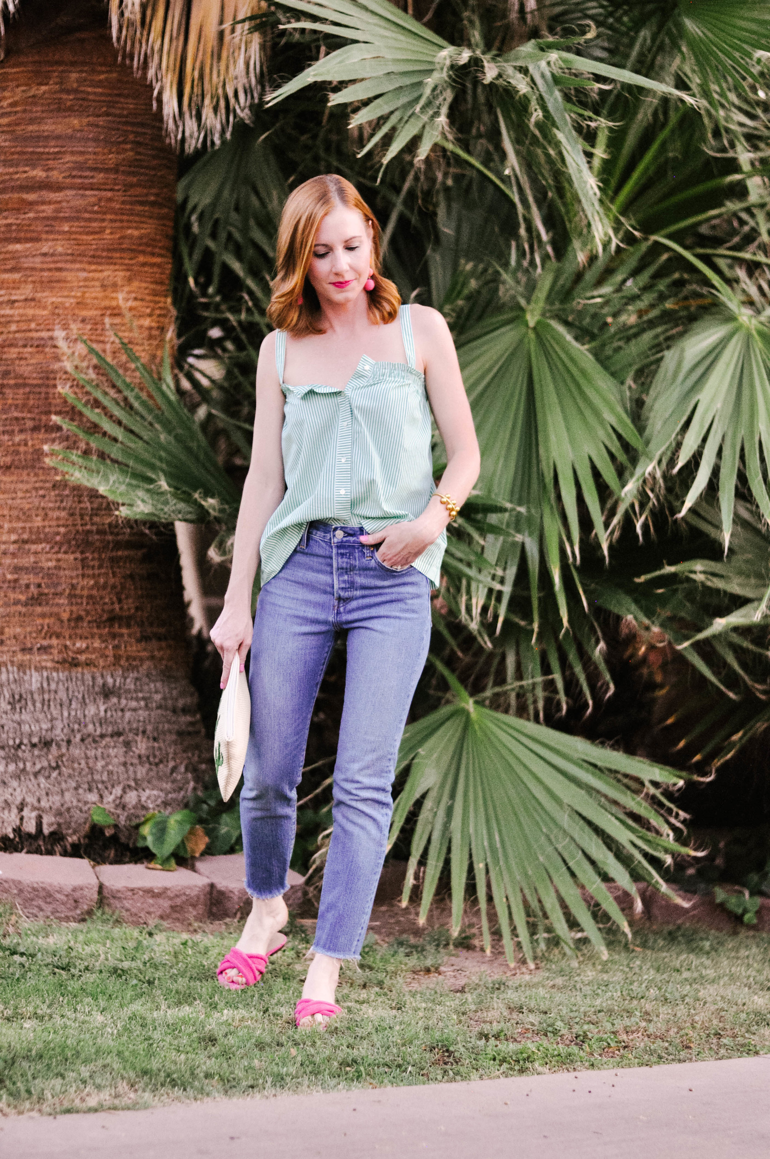 Woman Wearing J.Crew top and Levi's Jeans