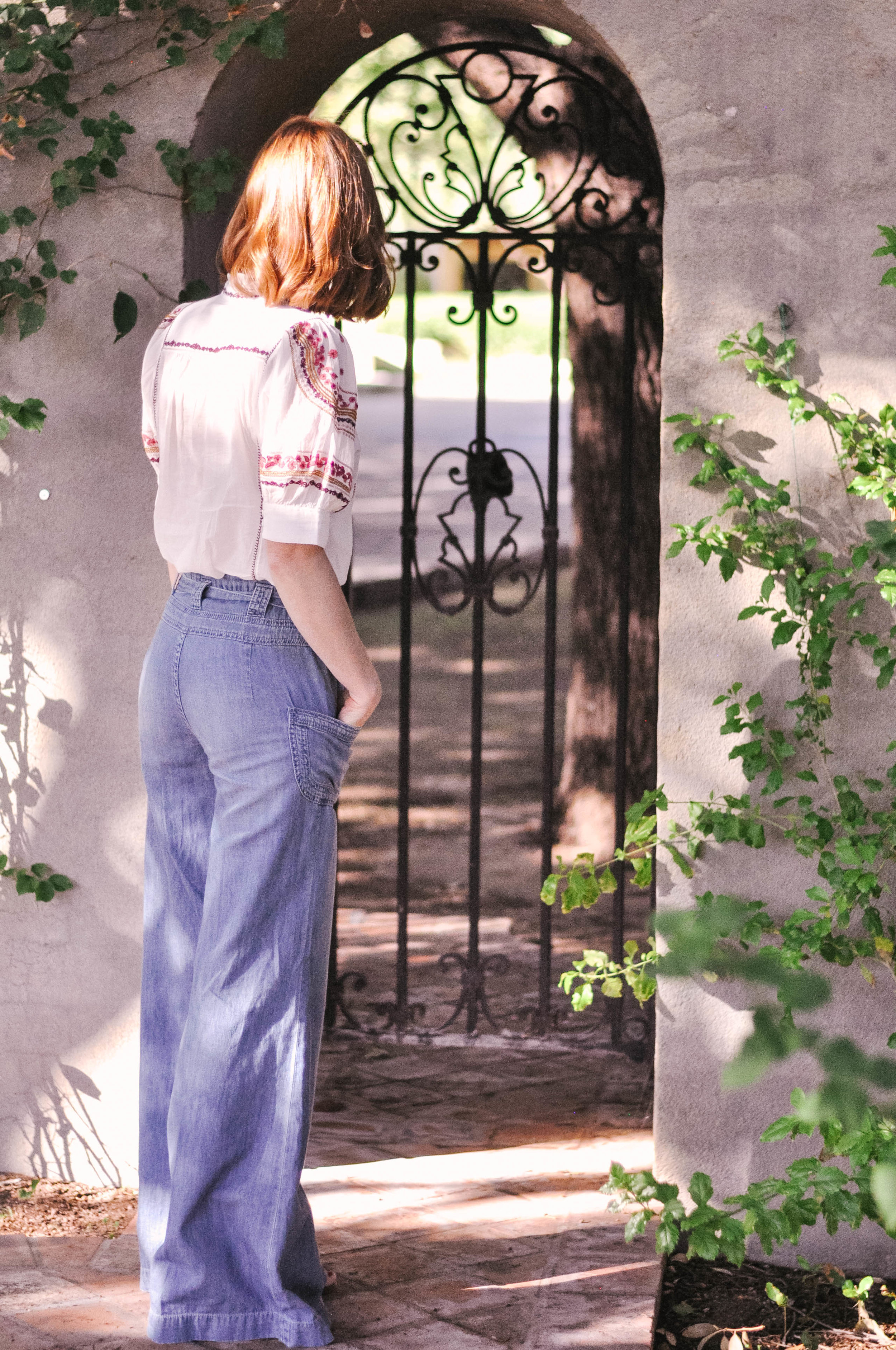 Fall Outfit with an Embroidered Anthropologie Top and Wide-Leg Jeans