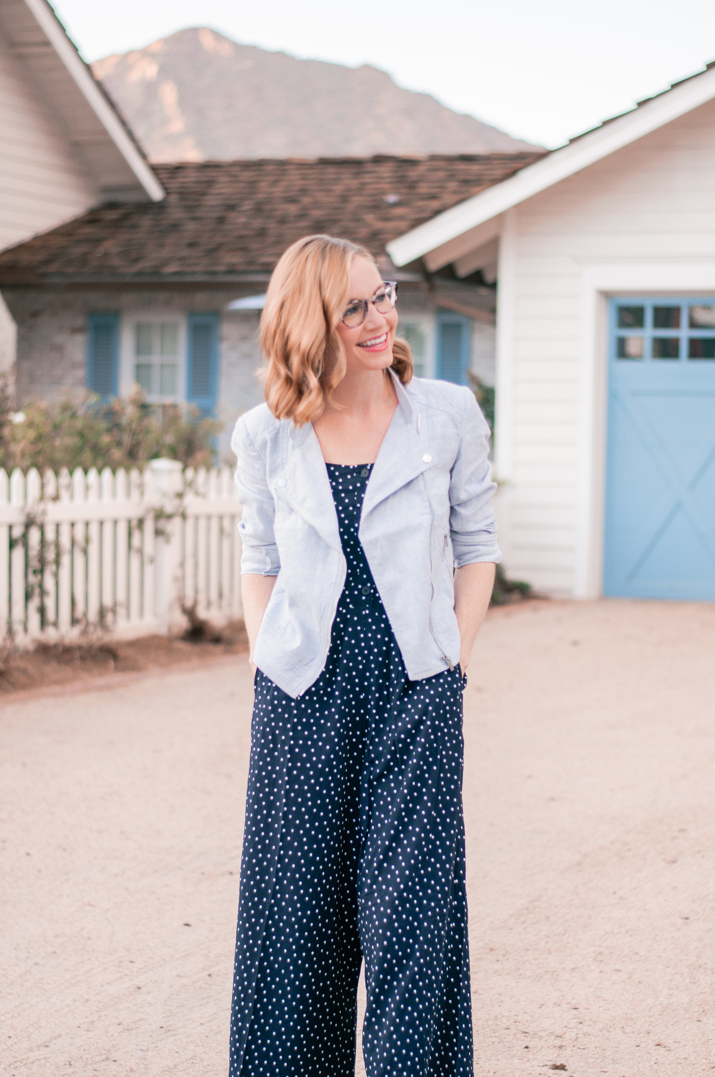 A casual navy blue jumpsuit with white polkadots for Fall