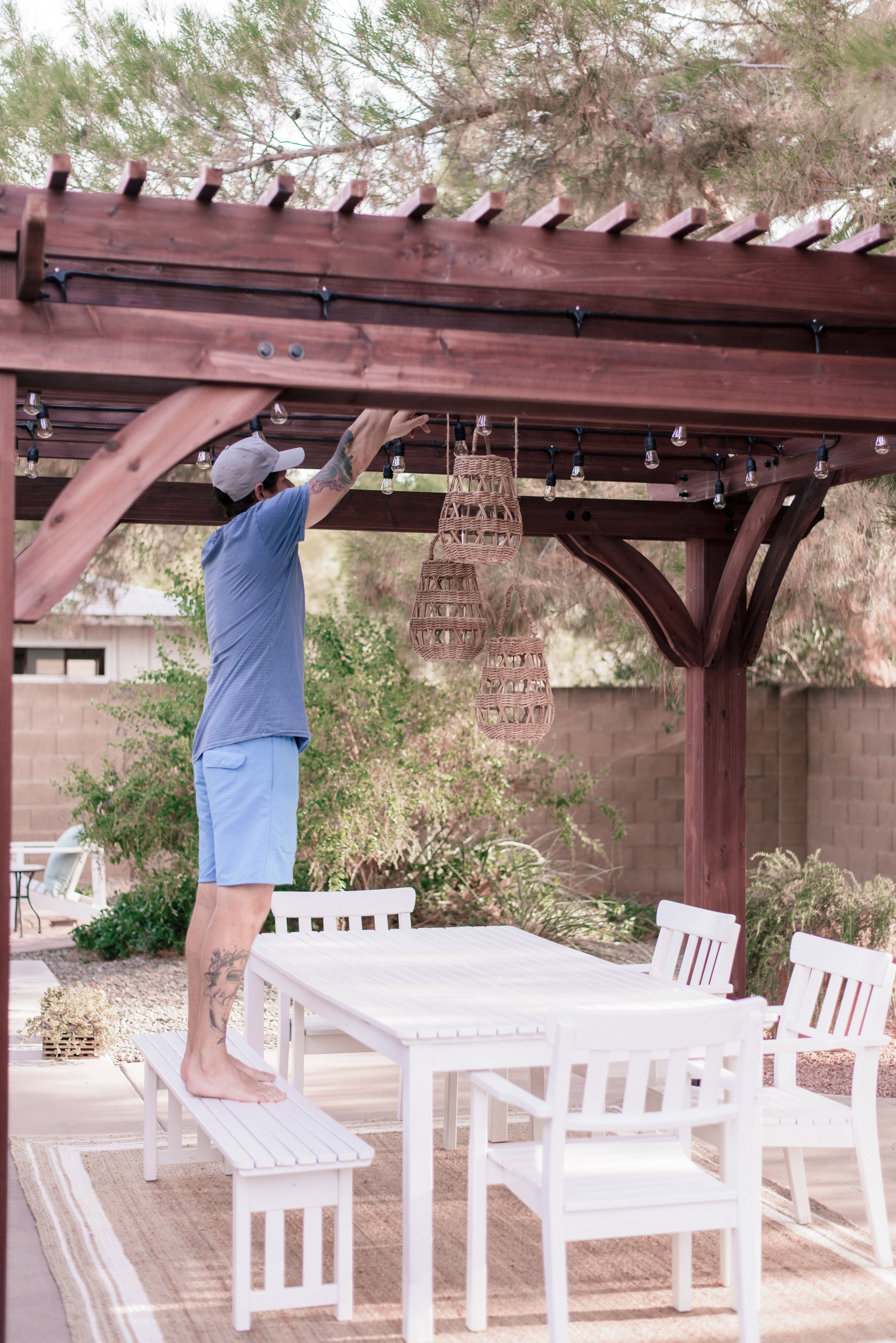 backyard patio pergola project with Home Depot and Leisure Time Product featured by top US lifestyle blog, Love + Specs: image of outdoor string lights under a wood backyard patio pergola