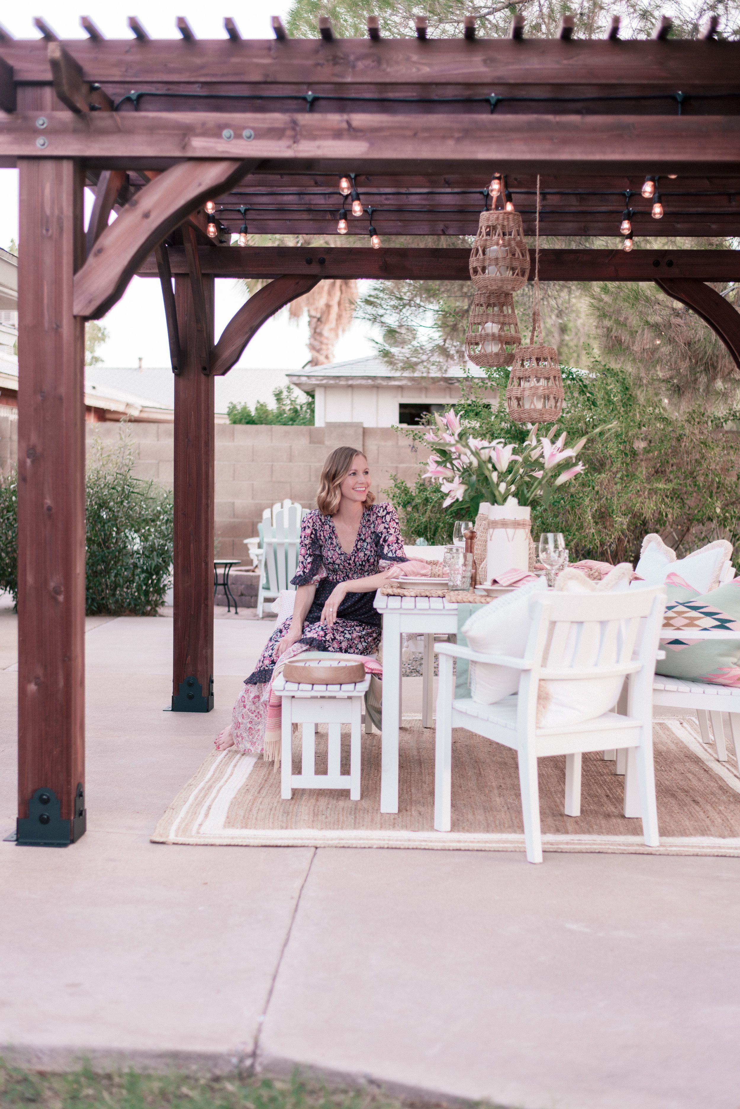 backyard patio pergola project with Home Depot and Leisure Time Product featured by top US lifestyle blog, Love + Specs: image of a woman under a wood backyard patio pergola