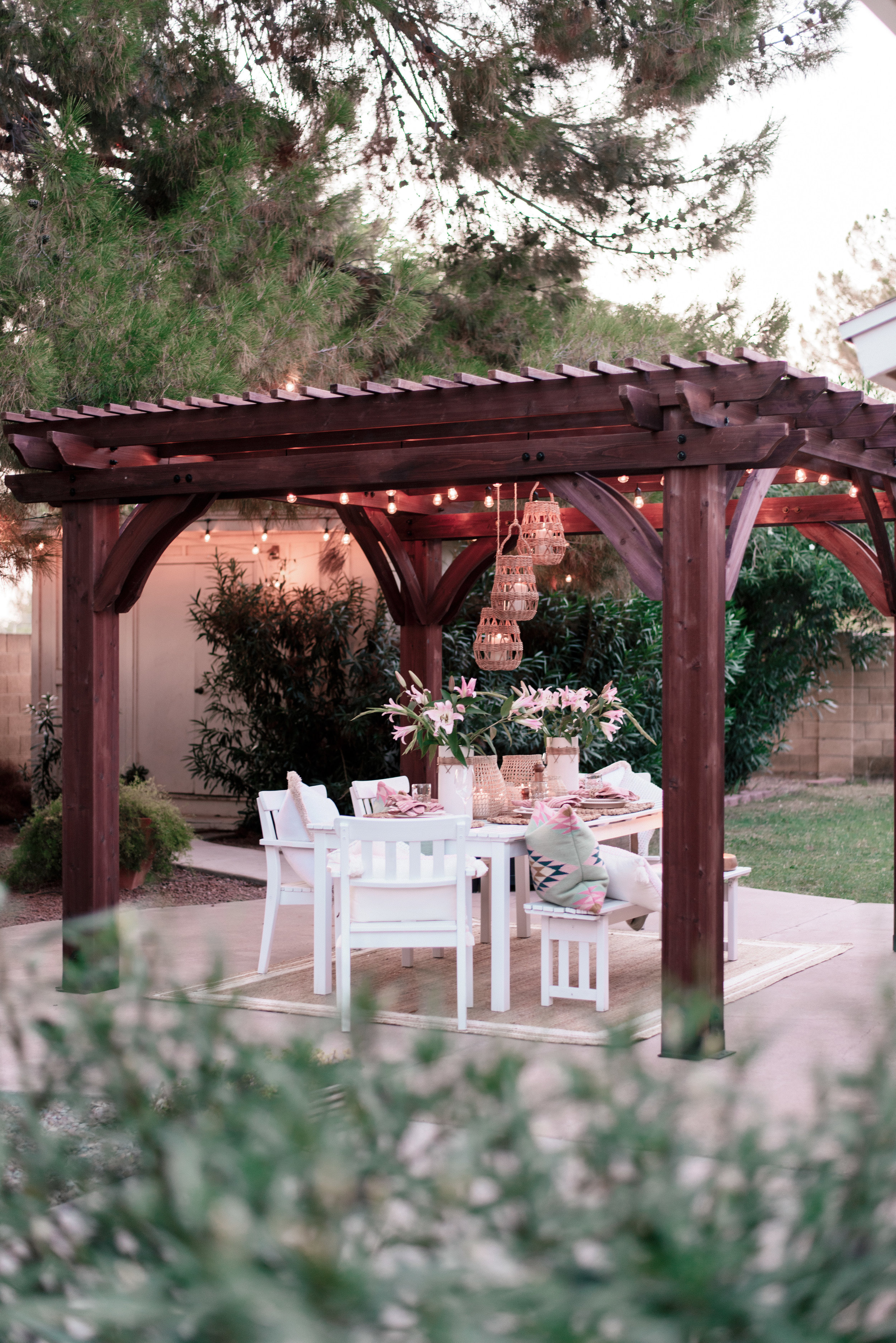 backyard patio pergola project with Home Depot and Leisure Time Product featured by top US lifestyle blog, Love + Specs: image of a white outdoor table under a wood backyard patio pergola