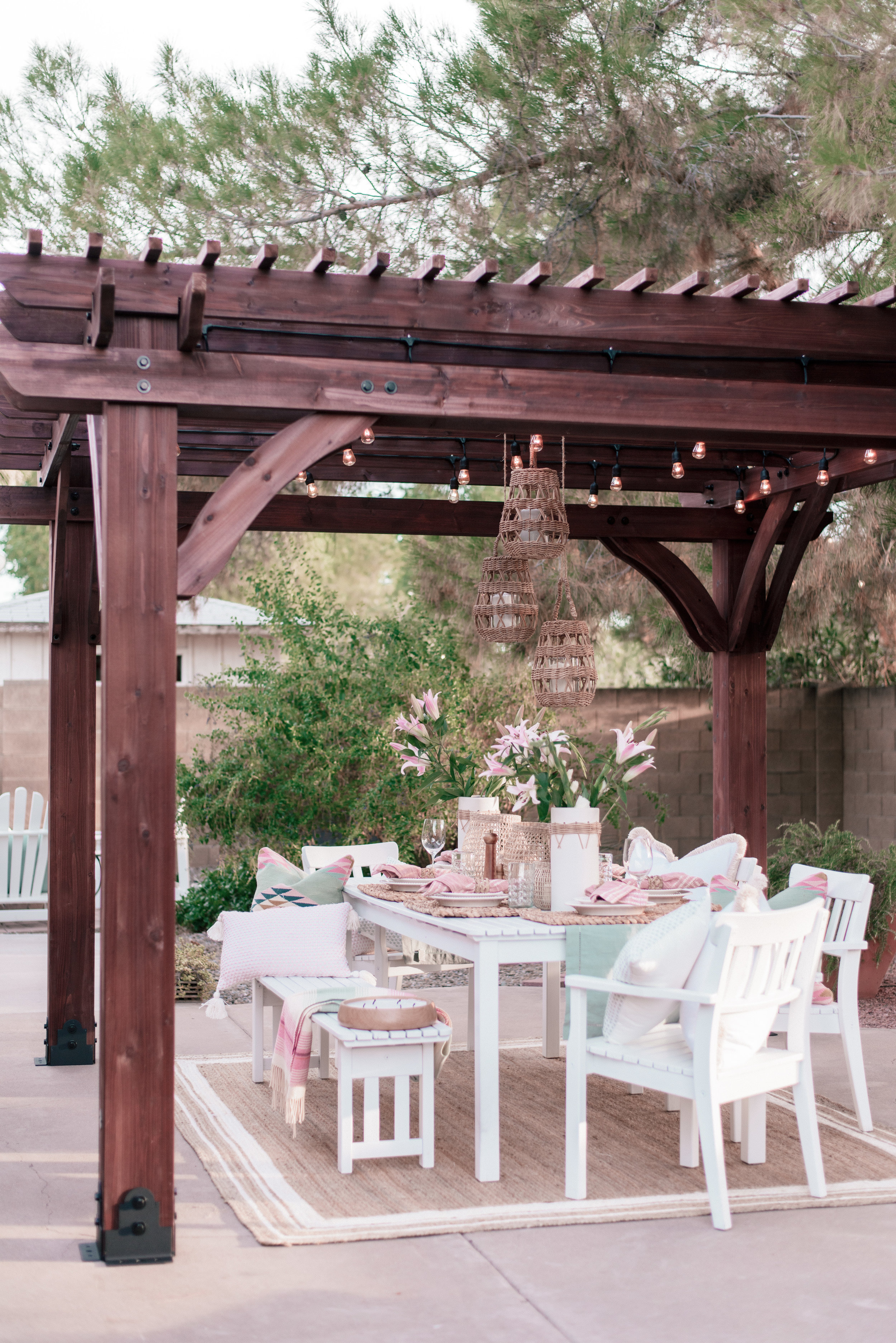 backyard patio pergola project with Home Depot and Leisure Time Product featured by top US lifestyle blog, Love + Specs: image of a white patio table under a wood backyard patio pergola