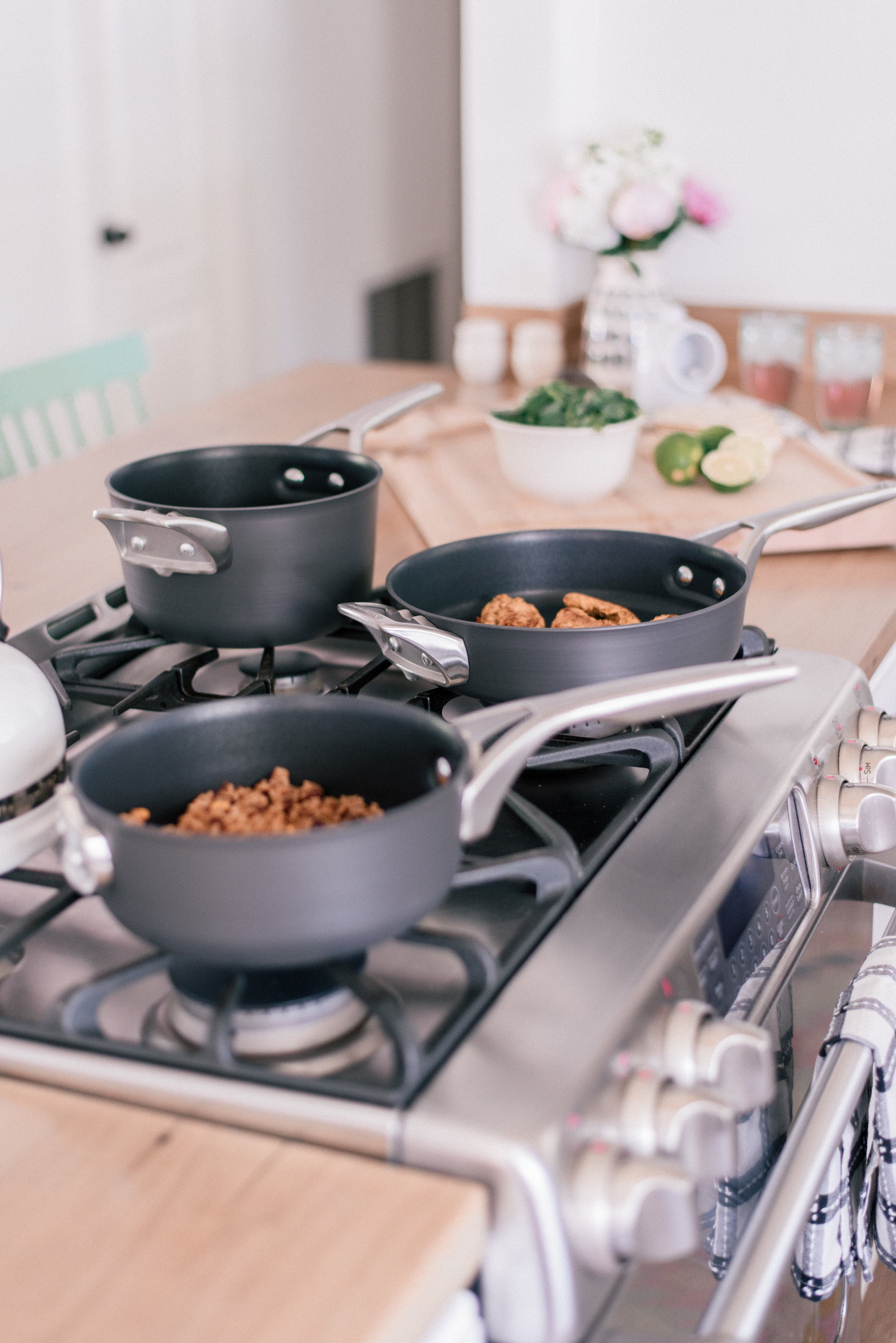 The Best Nonstick Cookware Sets with Calphalon and Bed Bath & Beyond featured by top U.S. Lifestyle blog Love + Specs: image of Calphalon nonstick cooking pans on cottage kitchen stove