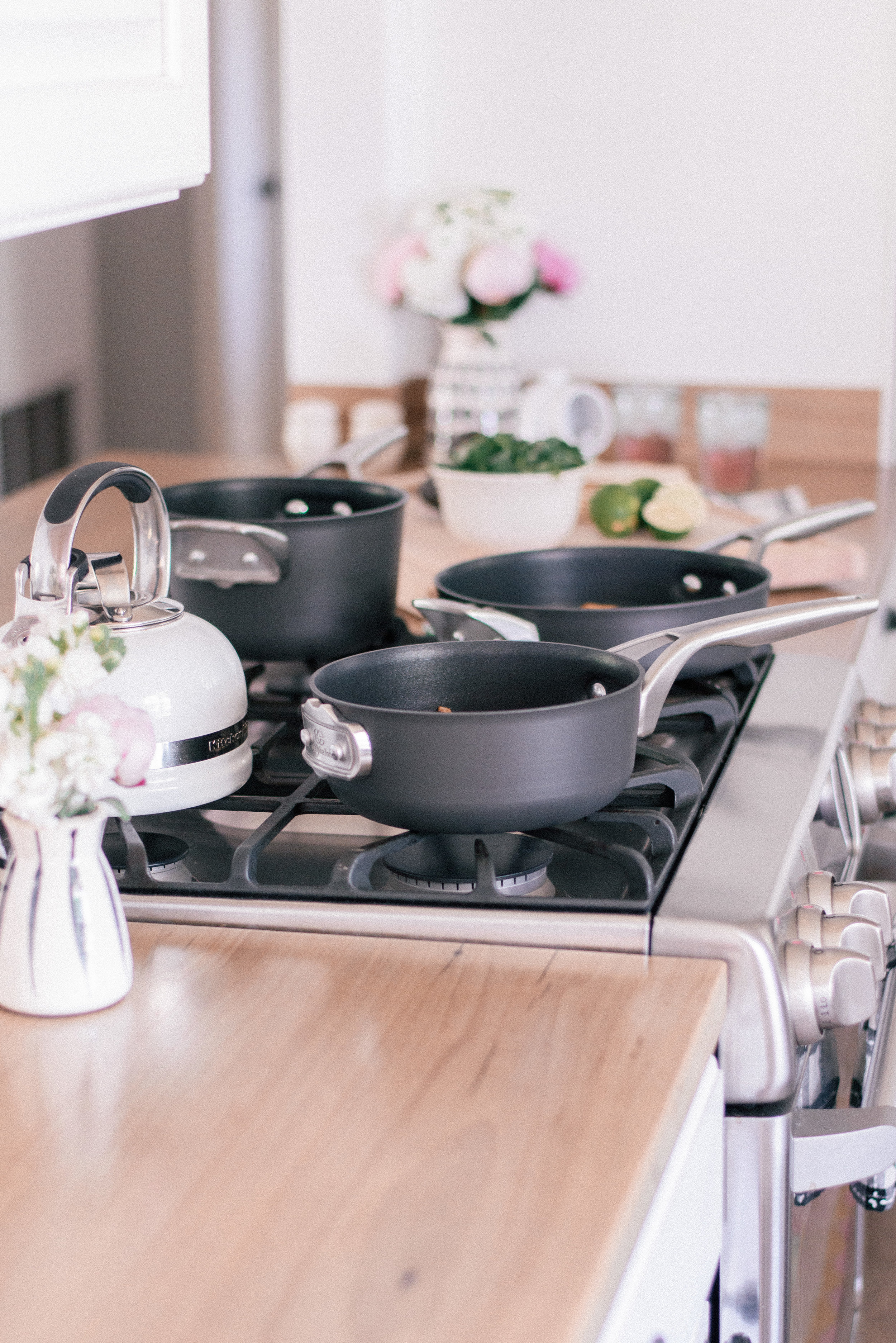 The Best Nonstick Cookware Sets with Calphalon and Bed Bath & Beyond featured by top U.S. Lifestyle blog Love + Specs: image of Calphalon pans on cottage kitchen stove