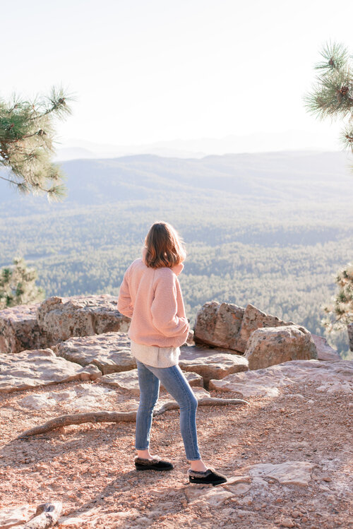20 fun fall bucket list ideas for families by top US lifestyle blog, Love + Specs: image of a woman on the Mogollon Rim in Arizona