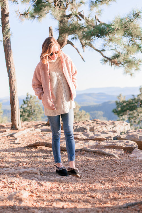 The best fun fall activity ideas for families by top US lifestyle blog, Love and Specs: image of a woman watching the sunset at the Mogollon Rim in Arizona