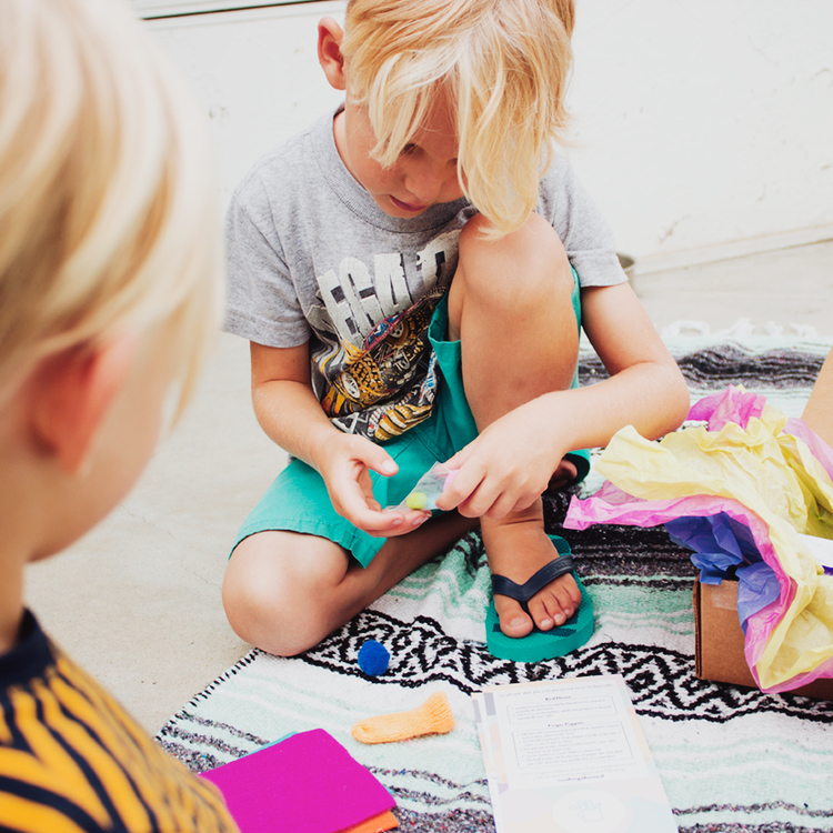 """"""" There were two crafts inside and the boys decided to do the finger puppets (leaving the birdie houses to Daddy another day). They each picked their colors, eye balls, pom poms, feathers and if they wanted a mouth or not."""" -Dani"""