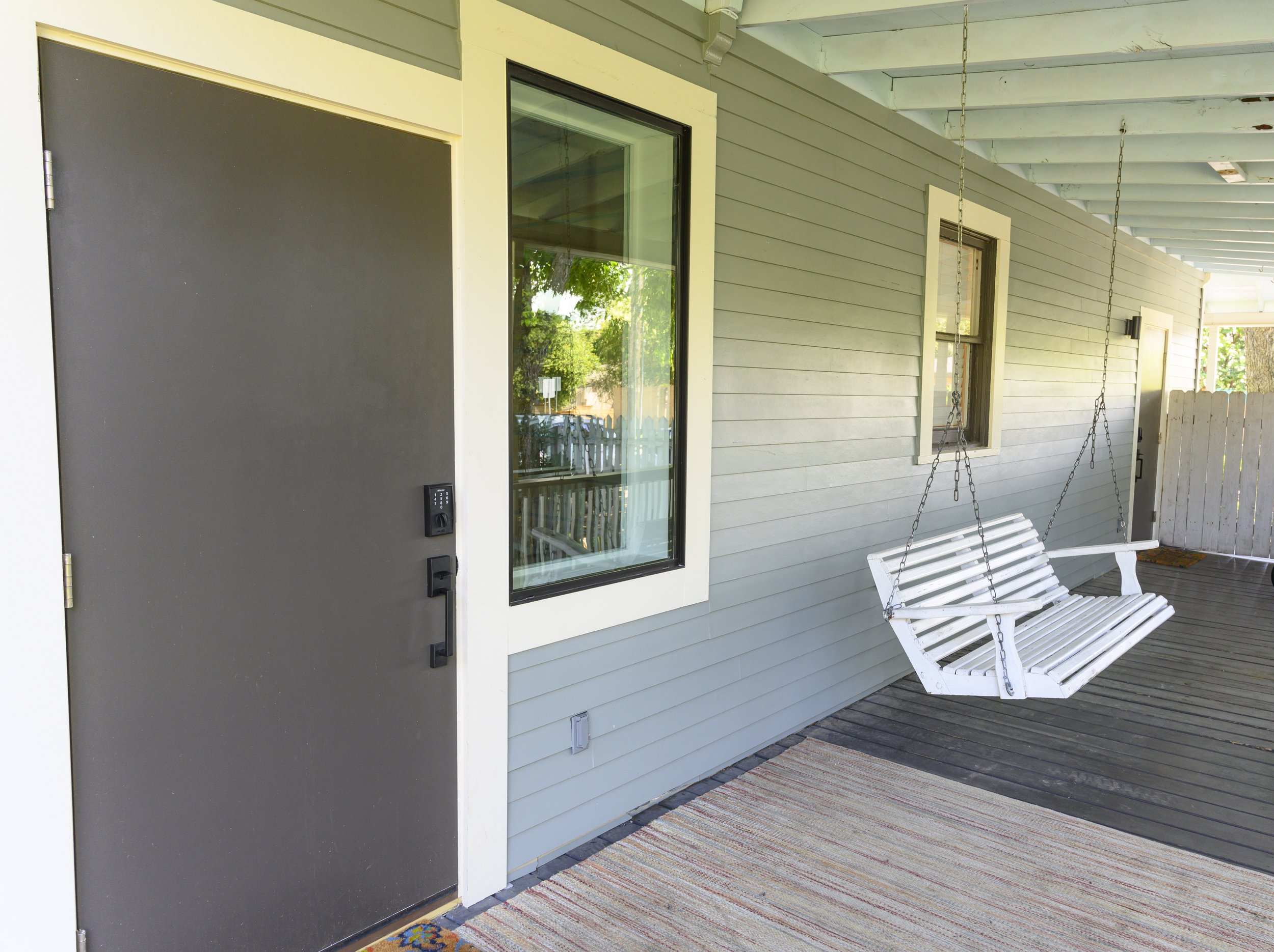 the porch swing… - A peaceful covered porch looks out over the yard. A nice place to sip some lemonade and re charge.