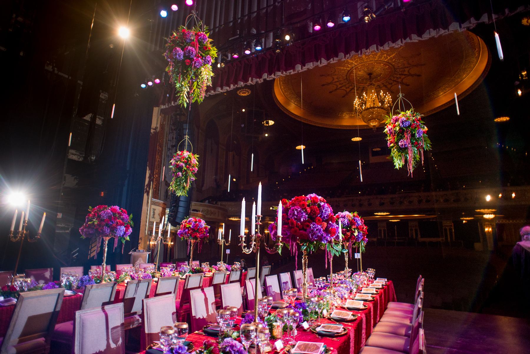 Gold candelabras, overflowing flowers on the table and hanging from above added so much drama to an already dramatic setting. It's not everyday an event is held on the  The Warner Theater stage. This venue is so opulent,unique and dramatic that we had to design the flowers on that level. The planner for this event chose such gorgeous linens, place settings and rentals and allowed us to go wild with the flowers. This will forever be one of my all time personal favorites. Photo above and below by  Erin Scott Photography  Catering by  Design Cuisine , rentals by  DC Rental