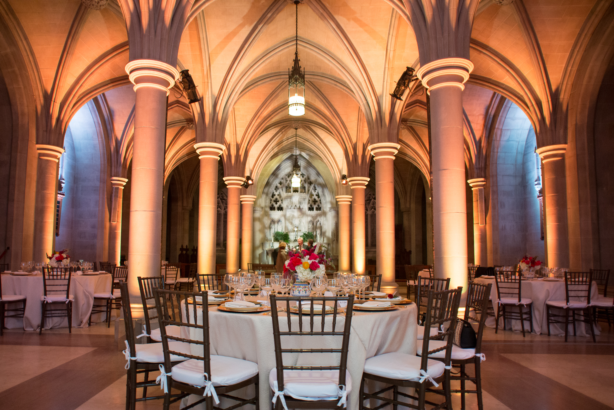 Did you know that  The National Cathedral  rents out various spaces for events? Make sure you get a fabulous lighting company like  Atmosphere Lighting  (shown above) to showcase the architecture. This event had a Spanish theme so we naturally used sangria pitchers made in Spain for vases. Photo by  Erin Scott Photography