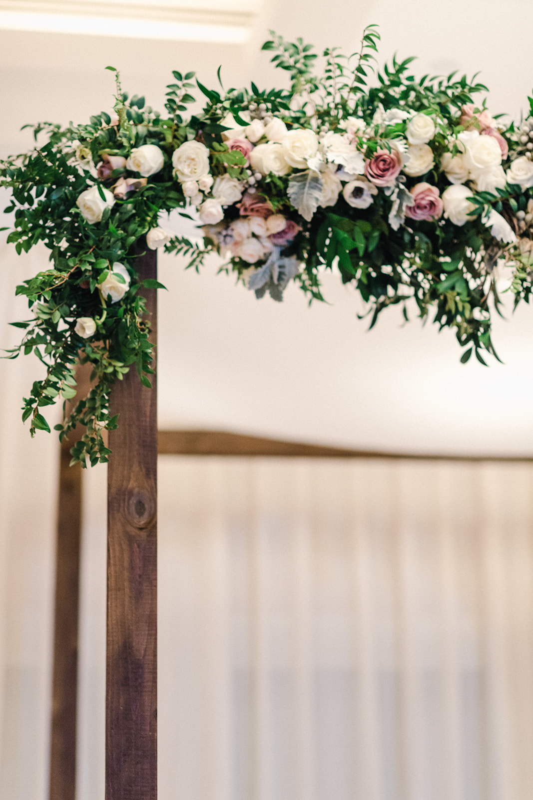 Floral garland on wood chuppah by B Floral DC