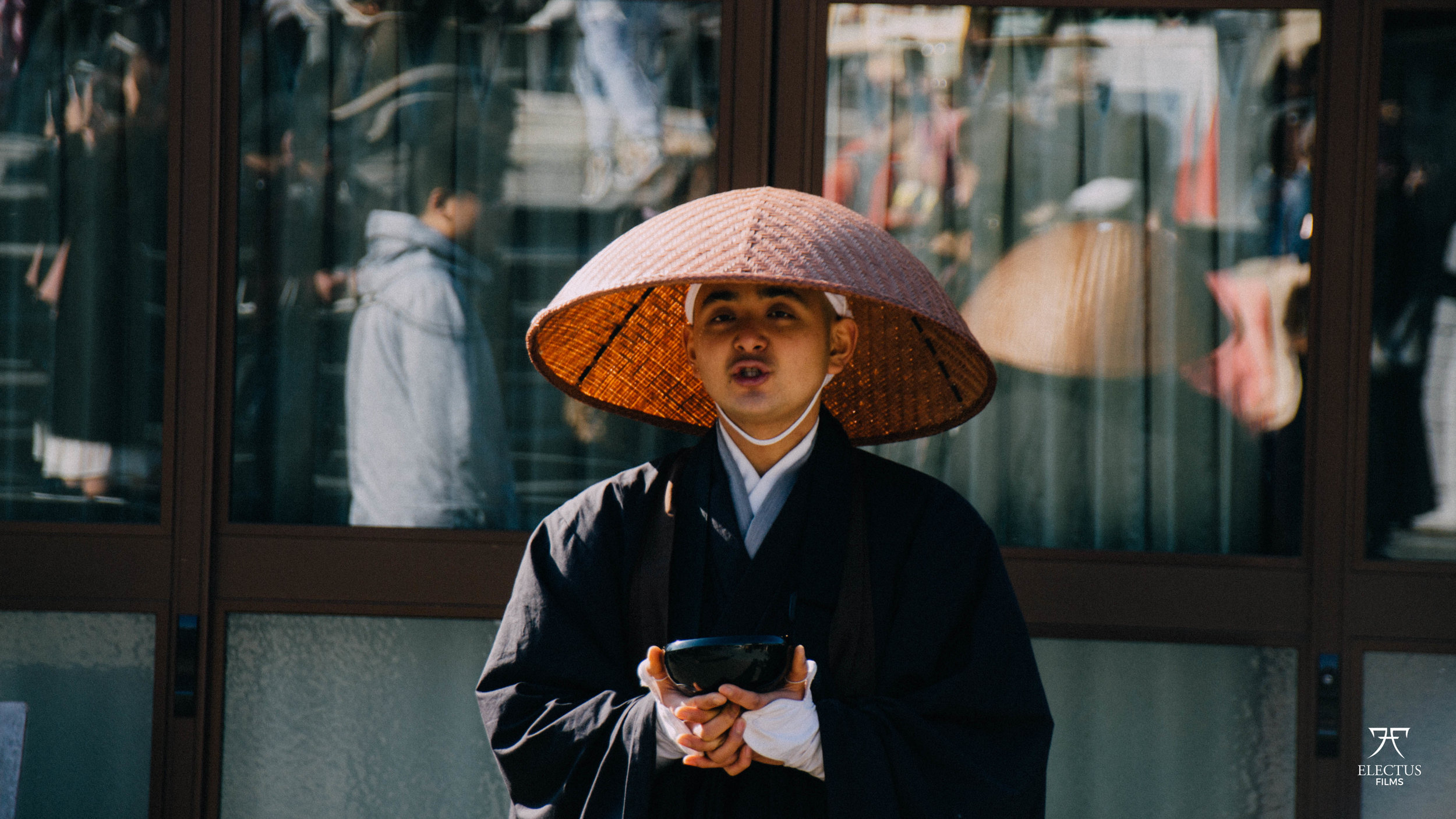 Portrait Shot of a praying Monk in Japan
