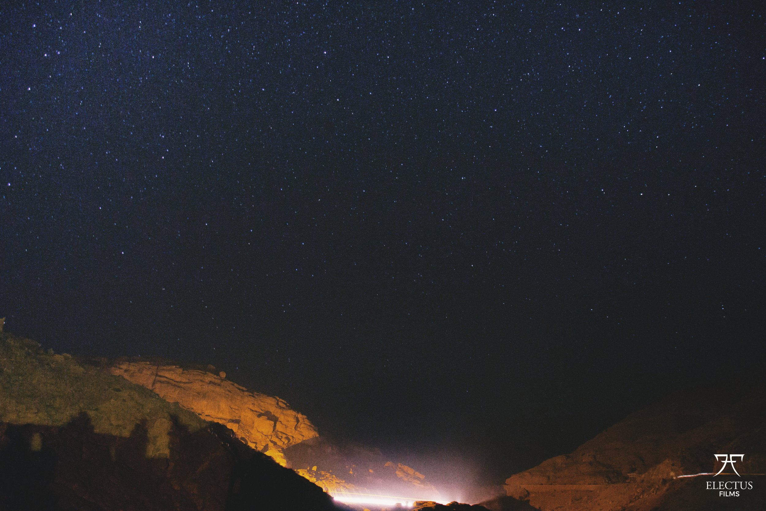 Nighttime photo from Morroco, capturing the starry night sky in a valley.