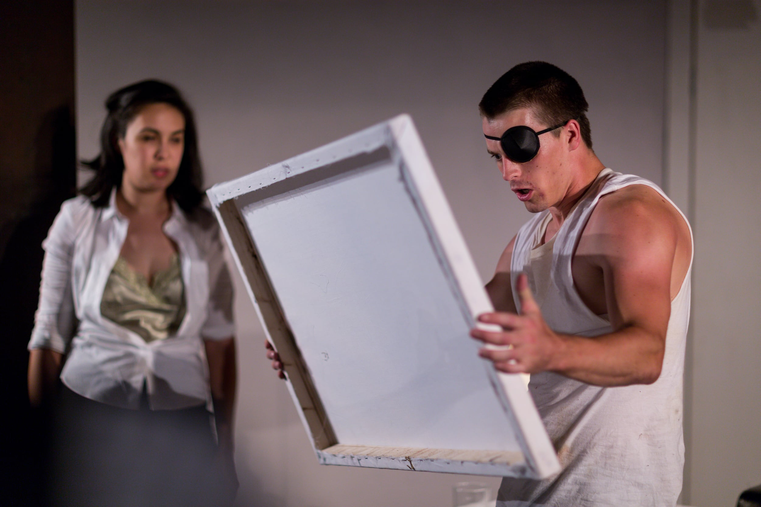 Joanna (Melissa deJesus) and Palmer (Michael Underhill) observe the masterpieces of Palmer's brother, Turner (Victor Shopov, unseen) (Photo Credit: Nile Scott Shots).