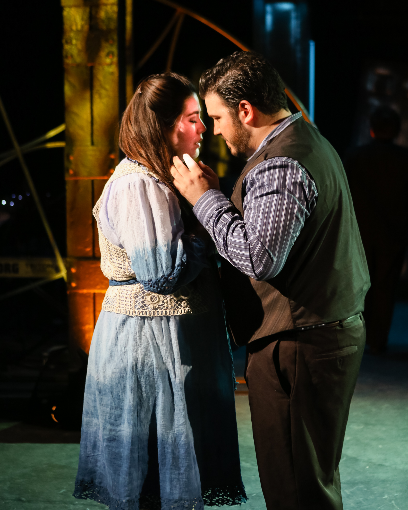 Marugerite (Emily Jensen) and Faust (Salvatore Atti) share a tender embrace in  Faust et Marguerite  (Photo Credit: Dan Busler).