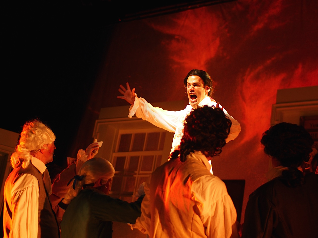 """Edward Rutledge (Andrew Giordano*) singing """"Molasses to Rum"""" in The Company Theatre's  1776  (Photo Credit: Zoe Bradford) (* Denotes a Member of Actors' Equity Association)."""