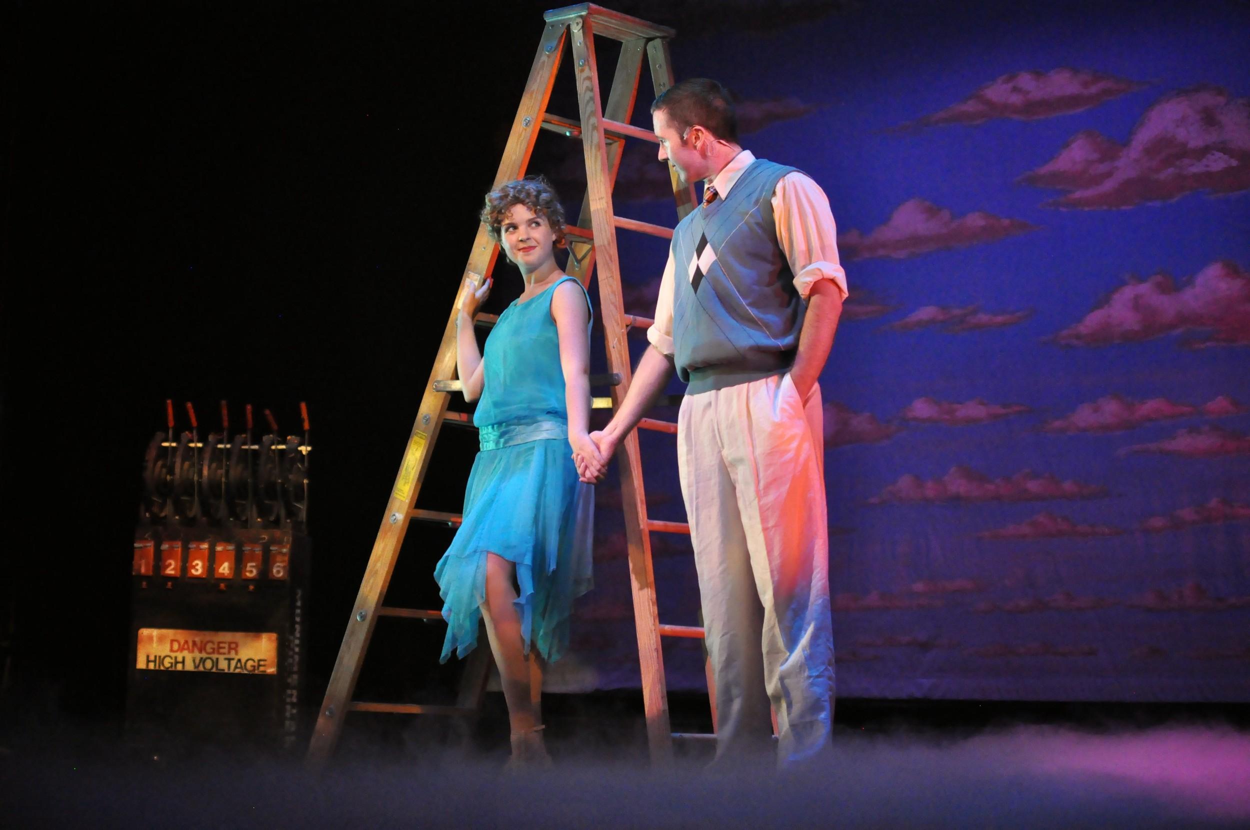 Gillian Mariner Gordon with Sean Quinn in   Singin' in the Rain  at  Reagle Music Theatre of Greater Boston  (Photo Credit:  Herb Philpott ).