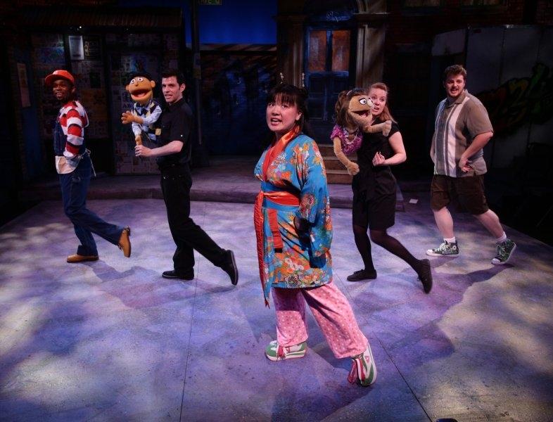 Jenna Lea Scott with Davron S. Monroe, John Ambrosino, Erica Spyres and Harry McEnerny in   Avenue Q  at  The Lyric Stage Company of Boston  (Photo Credit:  Mark S. Howard ).