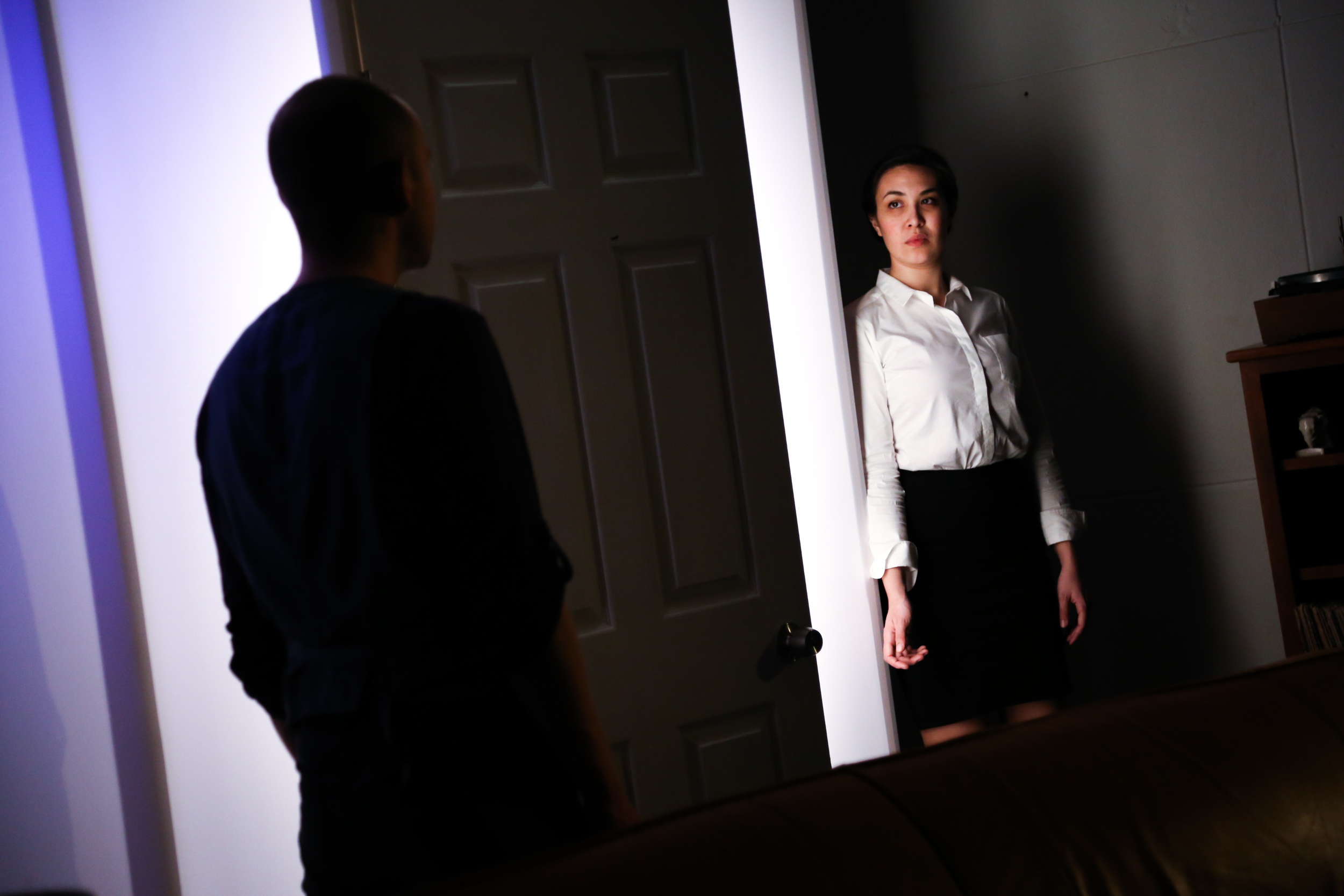 Johanna (Melissa deJesus) agrees to go home with Turner (Victor Shopov), but both of them are in for some surprises in Cassie M. Seinuk's  Eyes Shut. Door Open (Photo Credit:   Marc J. Franklin  ).