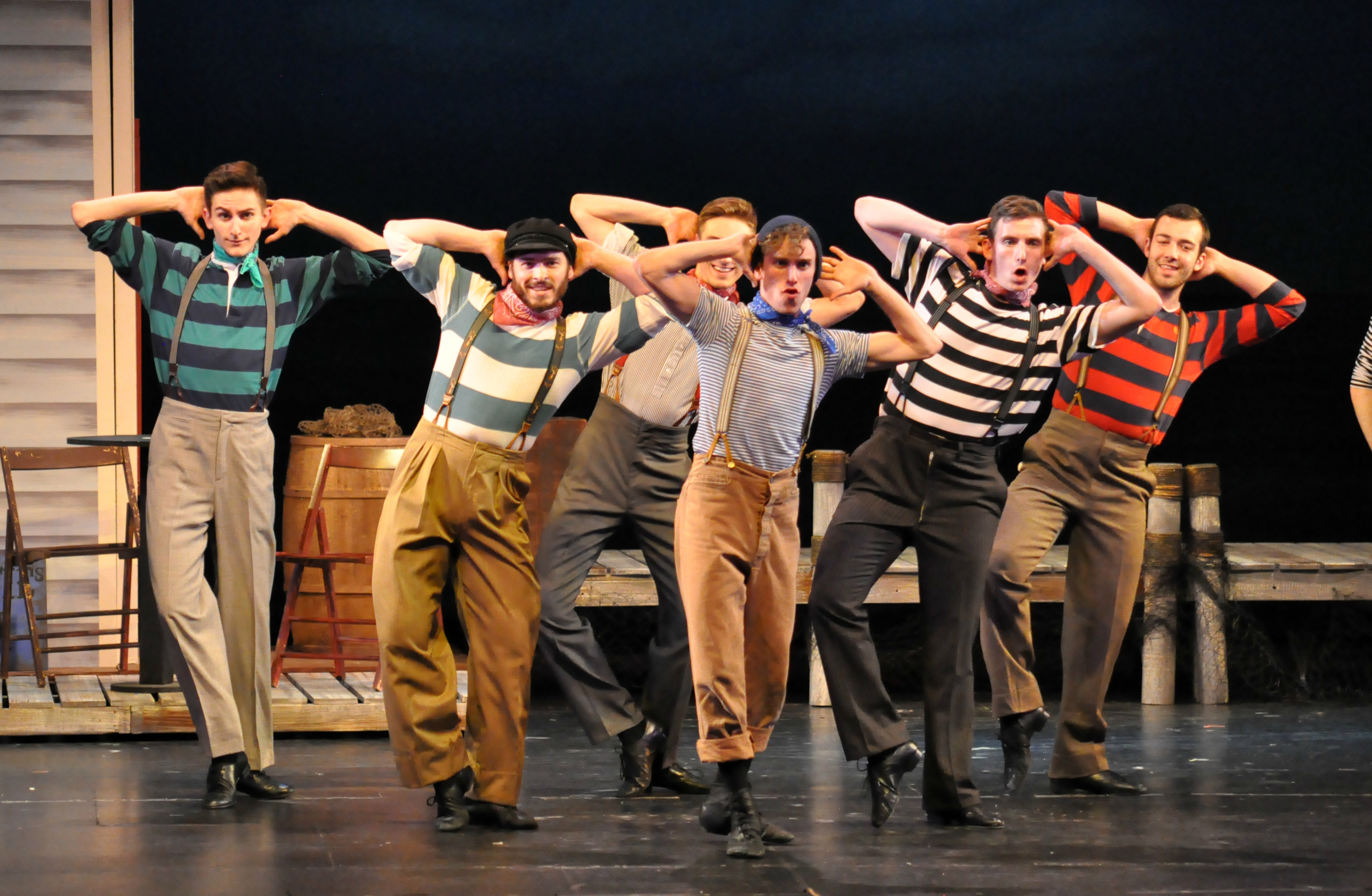"Some of the male ensemble in ""Blow High, Blow low"" in Reagle Music THeatre of Greater Boston's  Carousel  (Photo Credit: Reagle Music Theatre/©Herb Philpott)."
