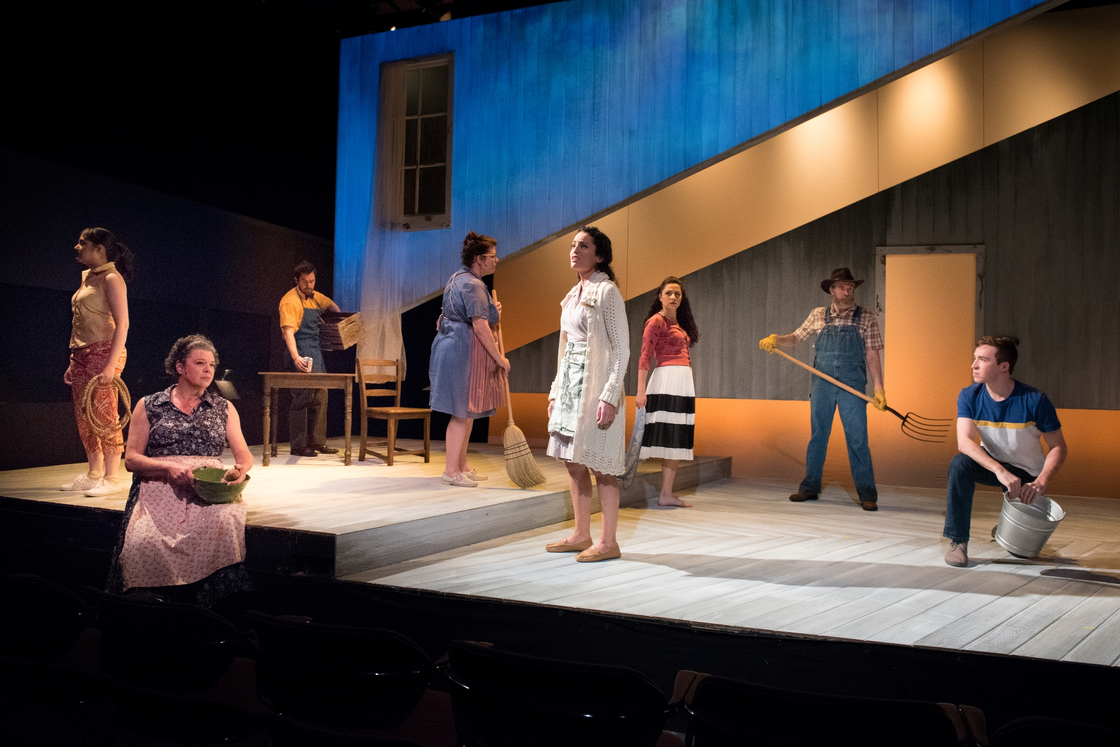 """Francesca ( Jennifer Ellis ) and the ensemble during """"To Build A Home"""" in SpeakEasy Stage Company's  The Bridges of Madison County . Photo by Glenn Perry."""