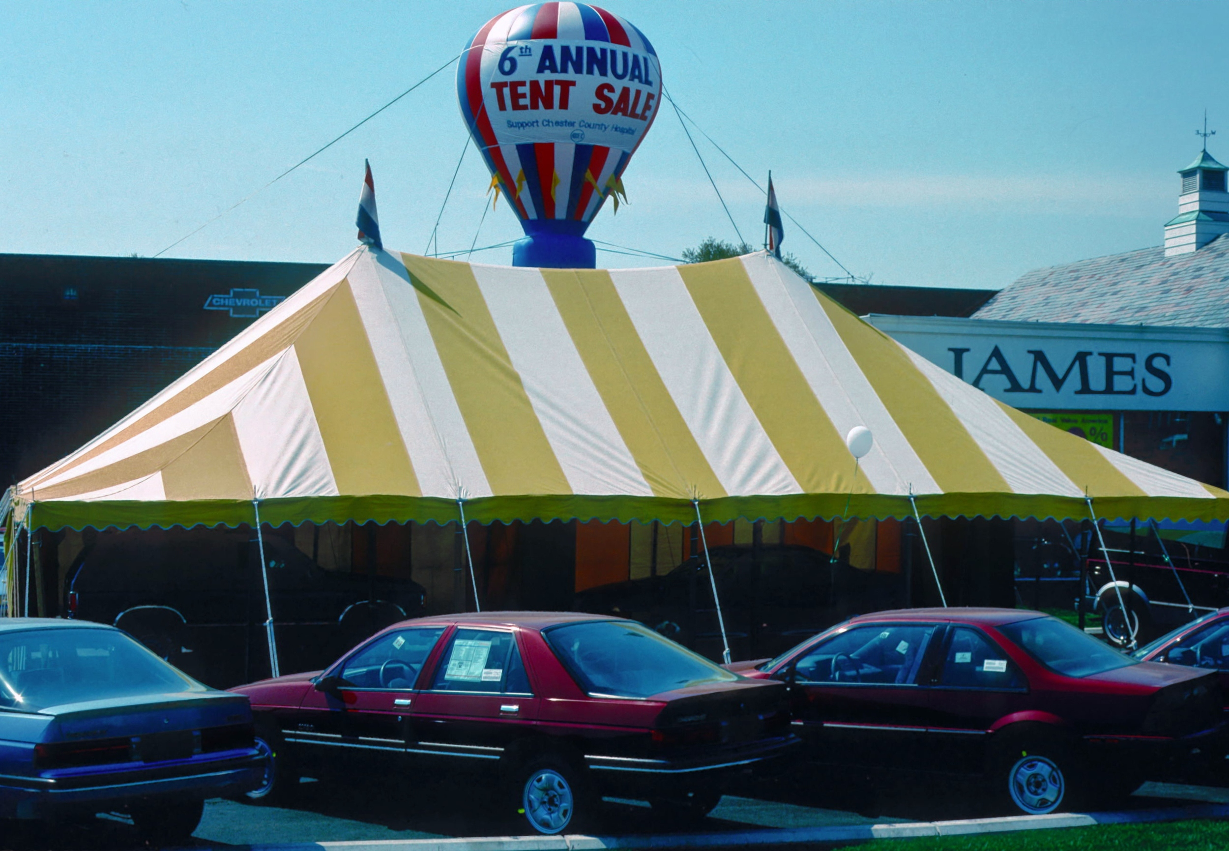 After green and yellow tents, we added yellow and white striped tents