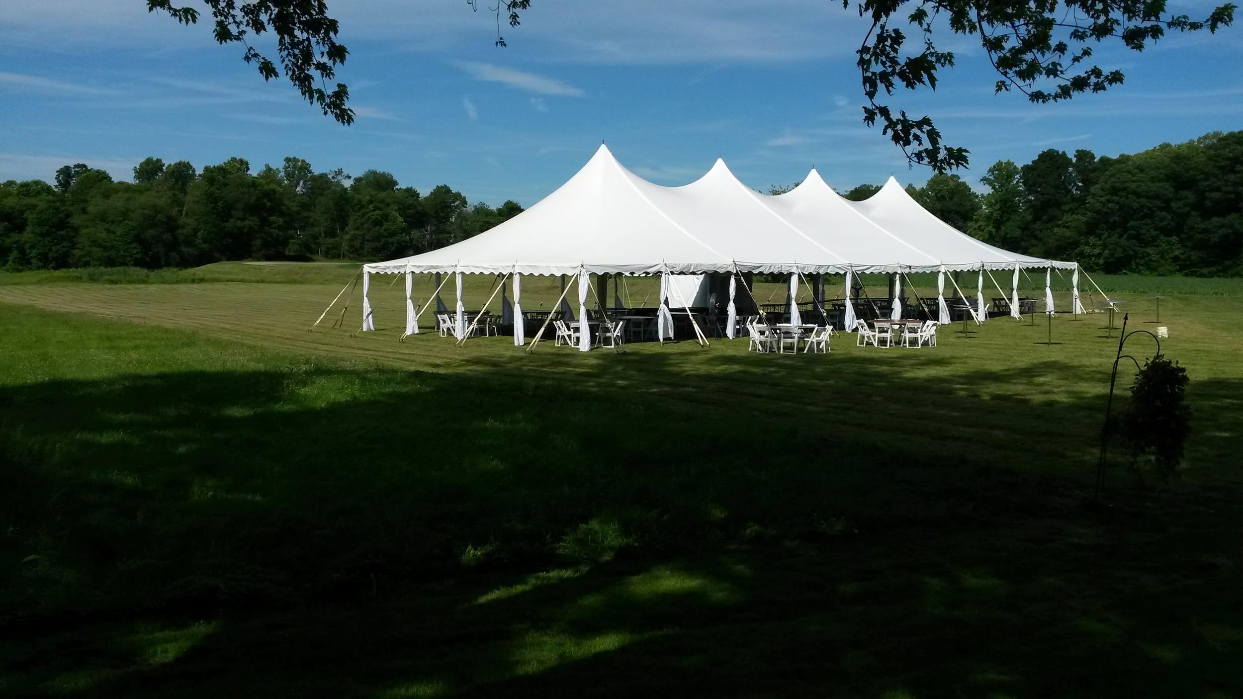 40x100 white tent with leg drapes