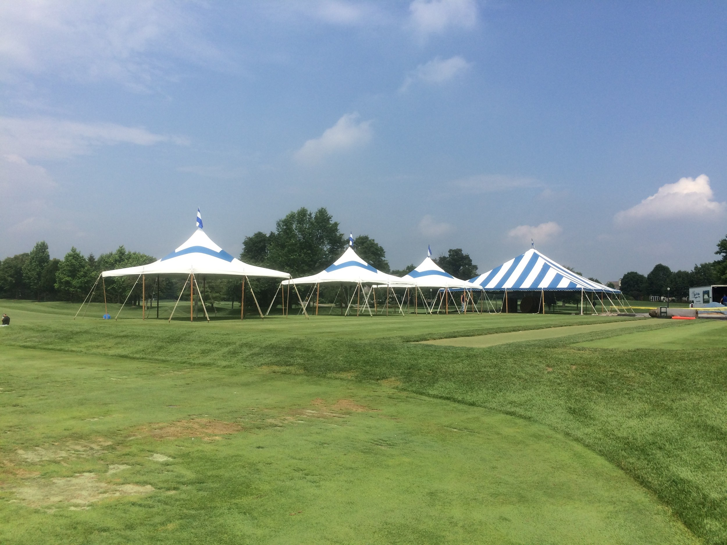40' wide and 20x20 blue tents