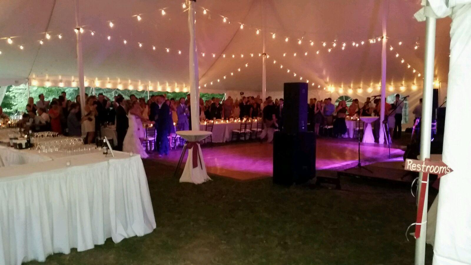 White wedding tent with cafe lights and dance floor