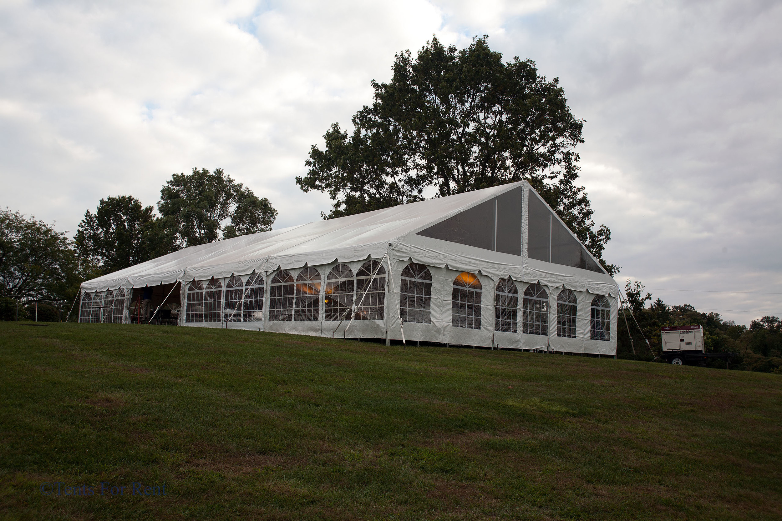 White frame tent with window sidewall