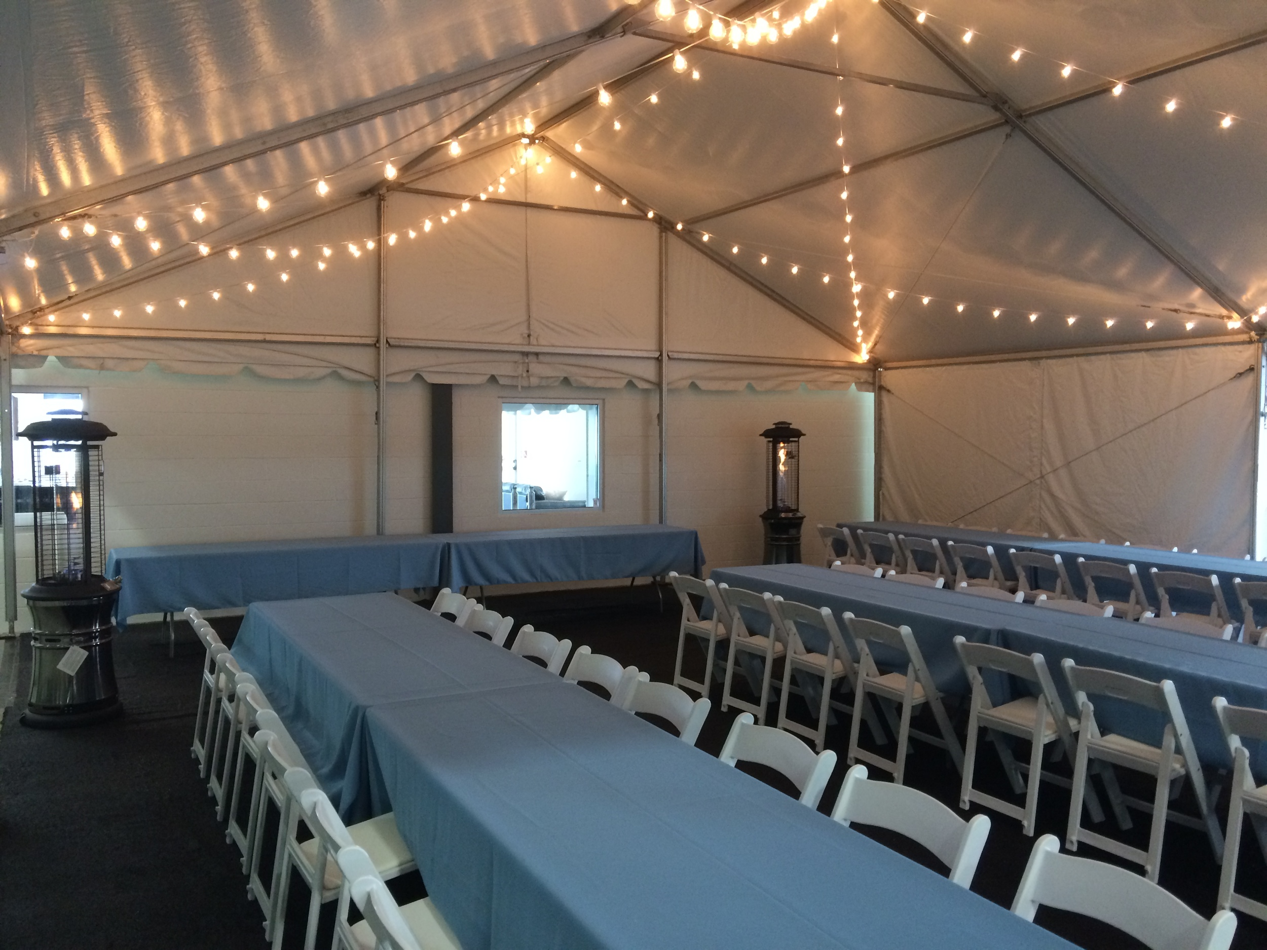 White padded chairs and 8' banquet tables
