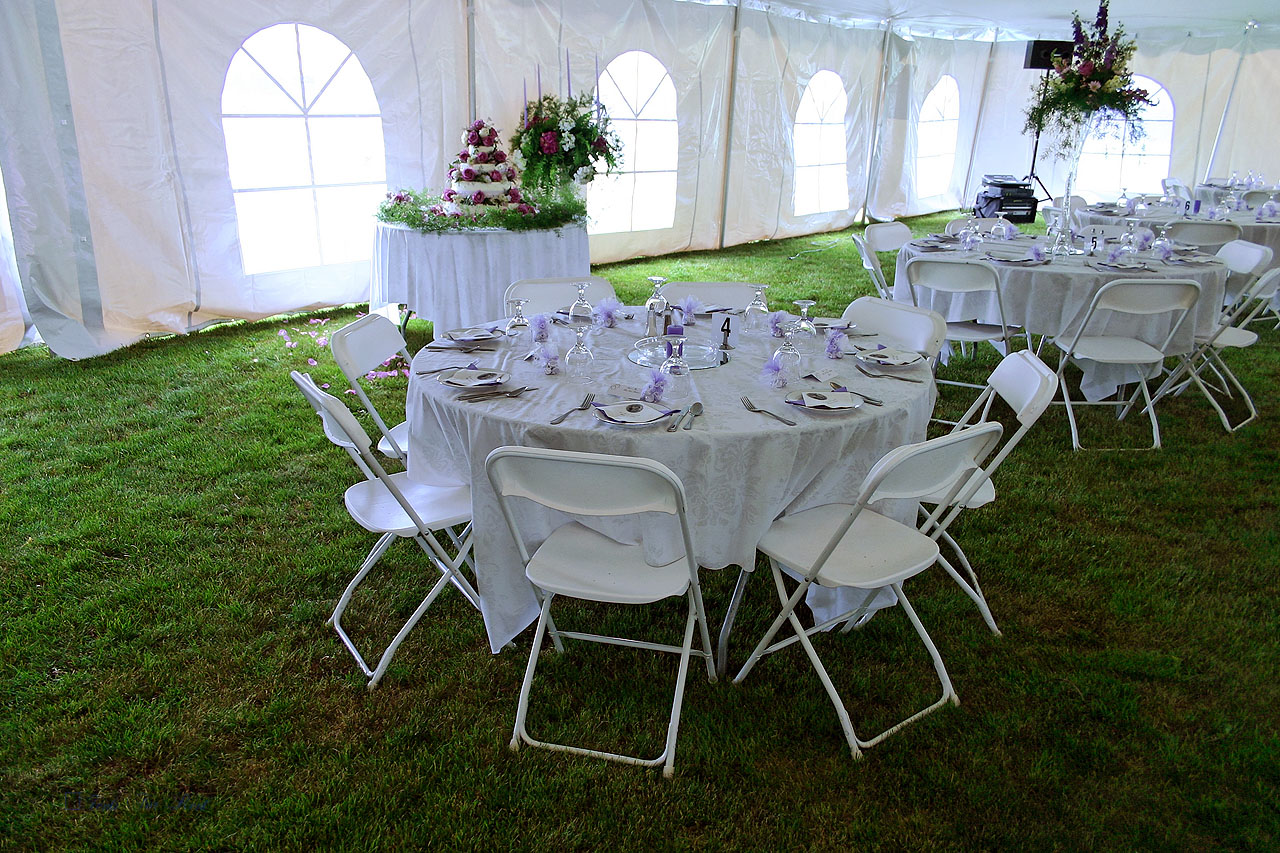 "White folding chairs and 60"" round table"