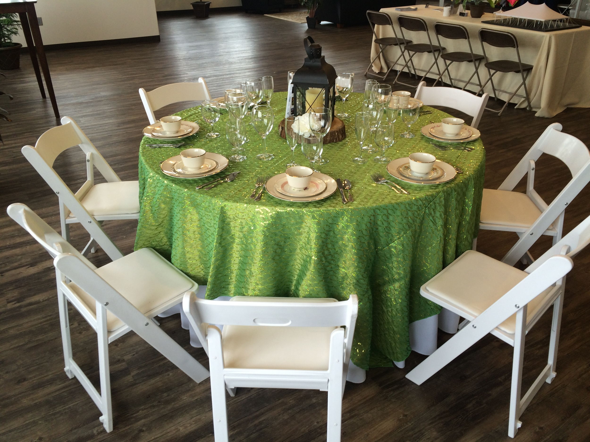 "White padded chairs and 60"" round table"