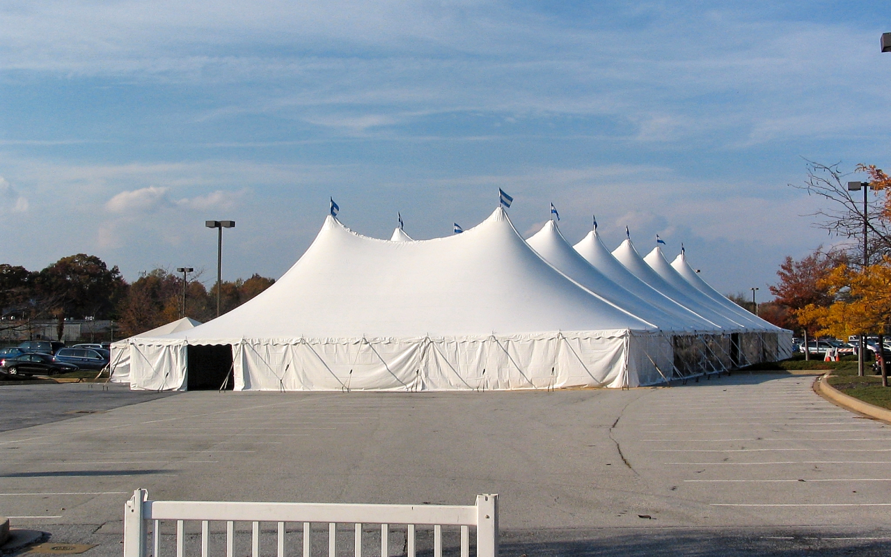 Large tent with solid white sidewalls