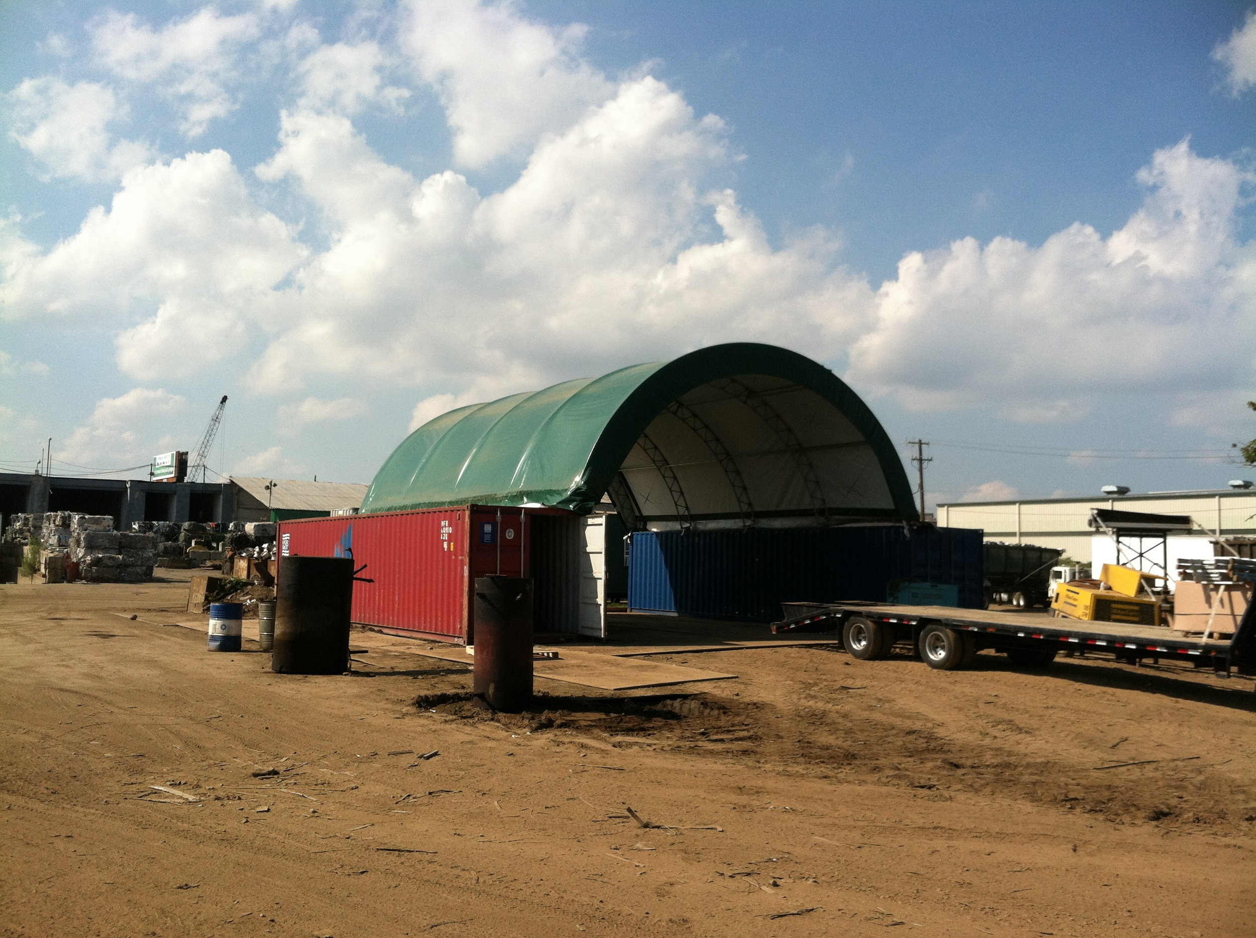 Tent fastened to shipping containers