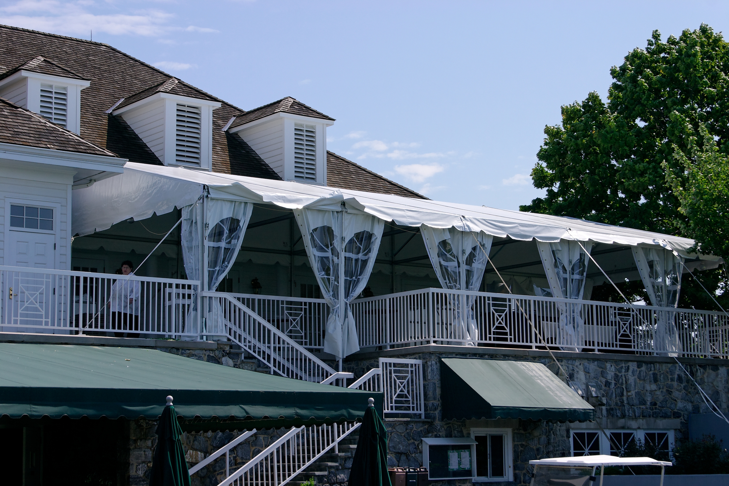 Tent on a second story patio as a restaurant