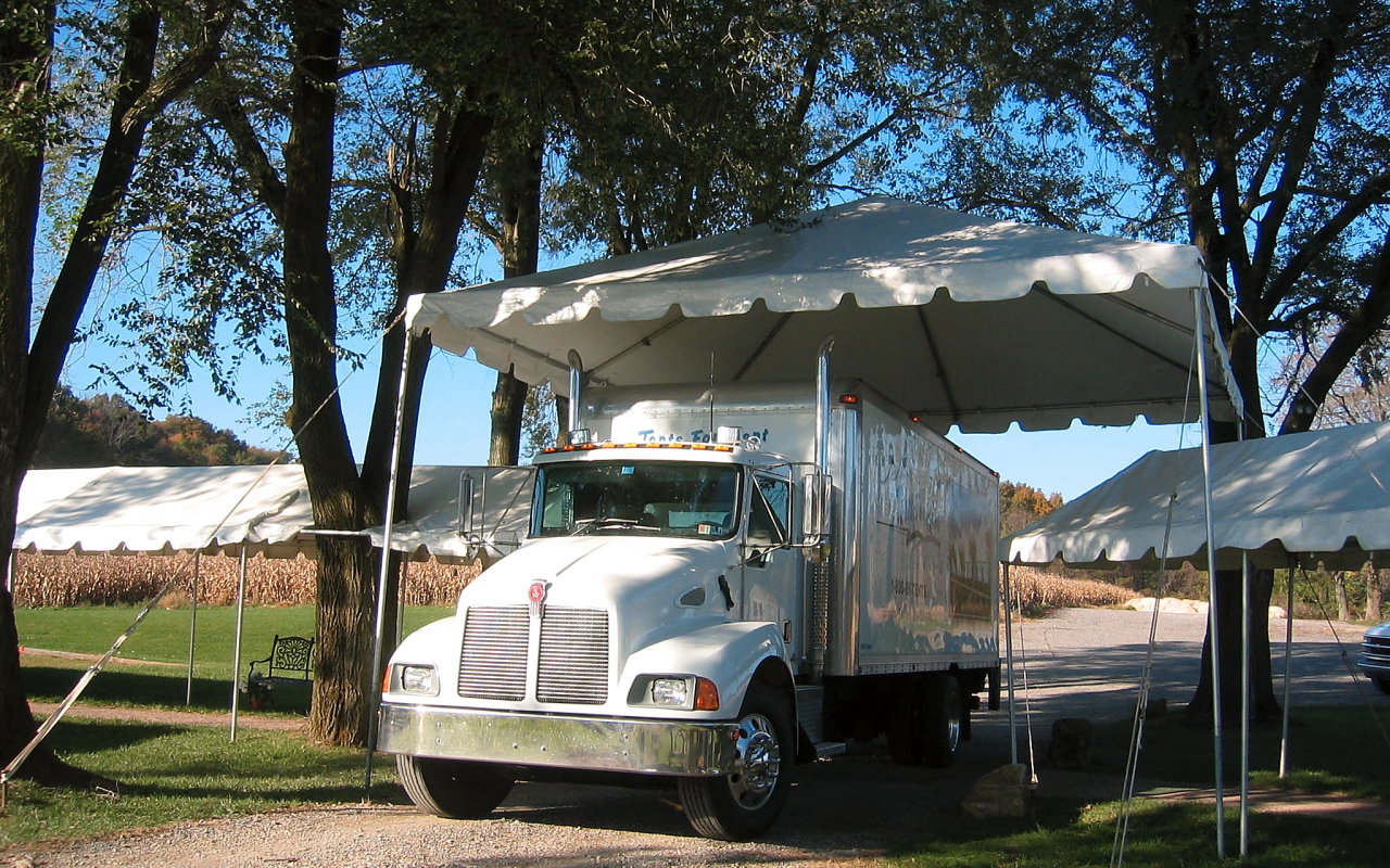 Tent over a vehicle entrance