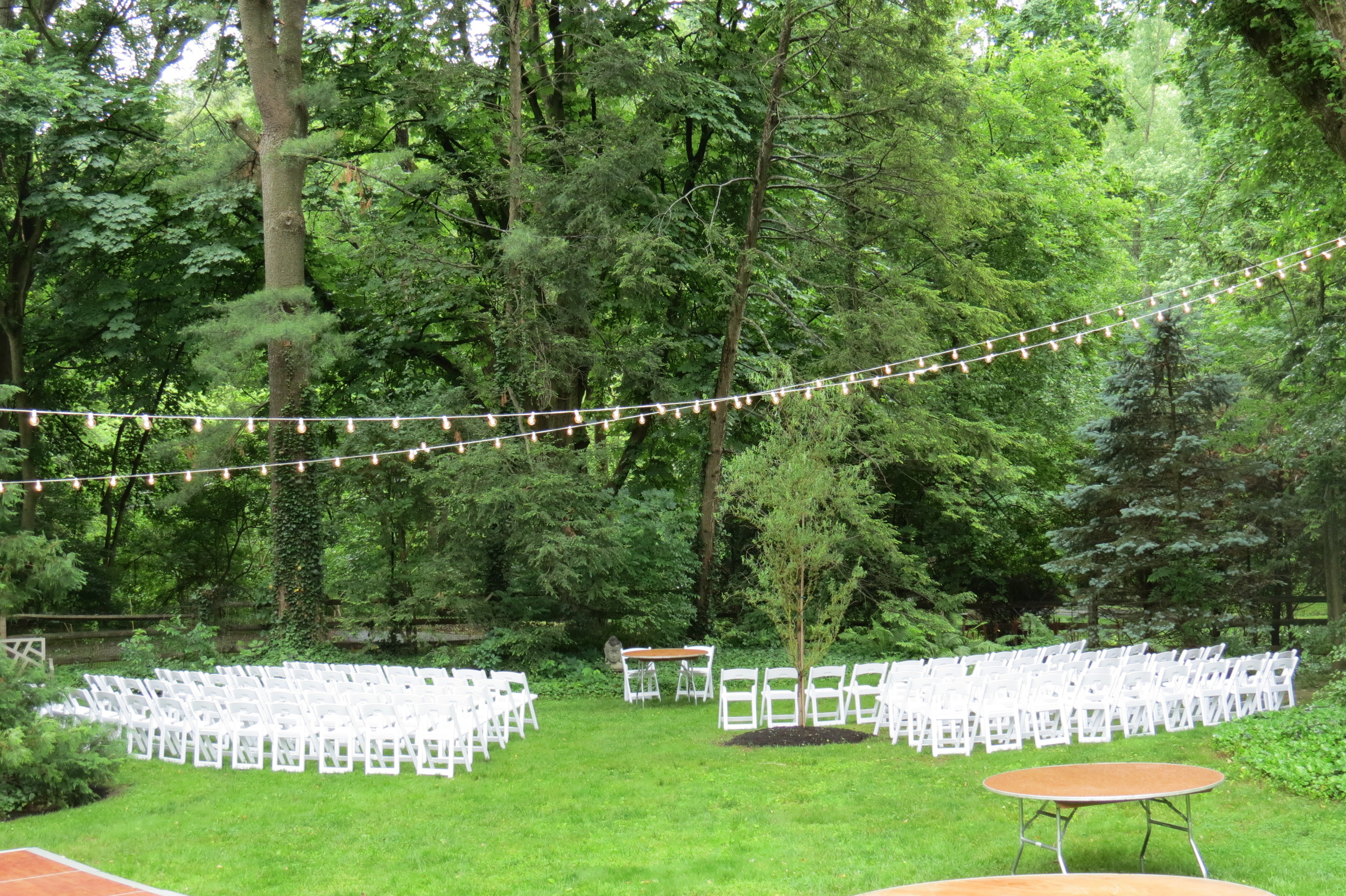 Chairs and lighting for outdoor wedding