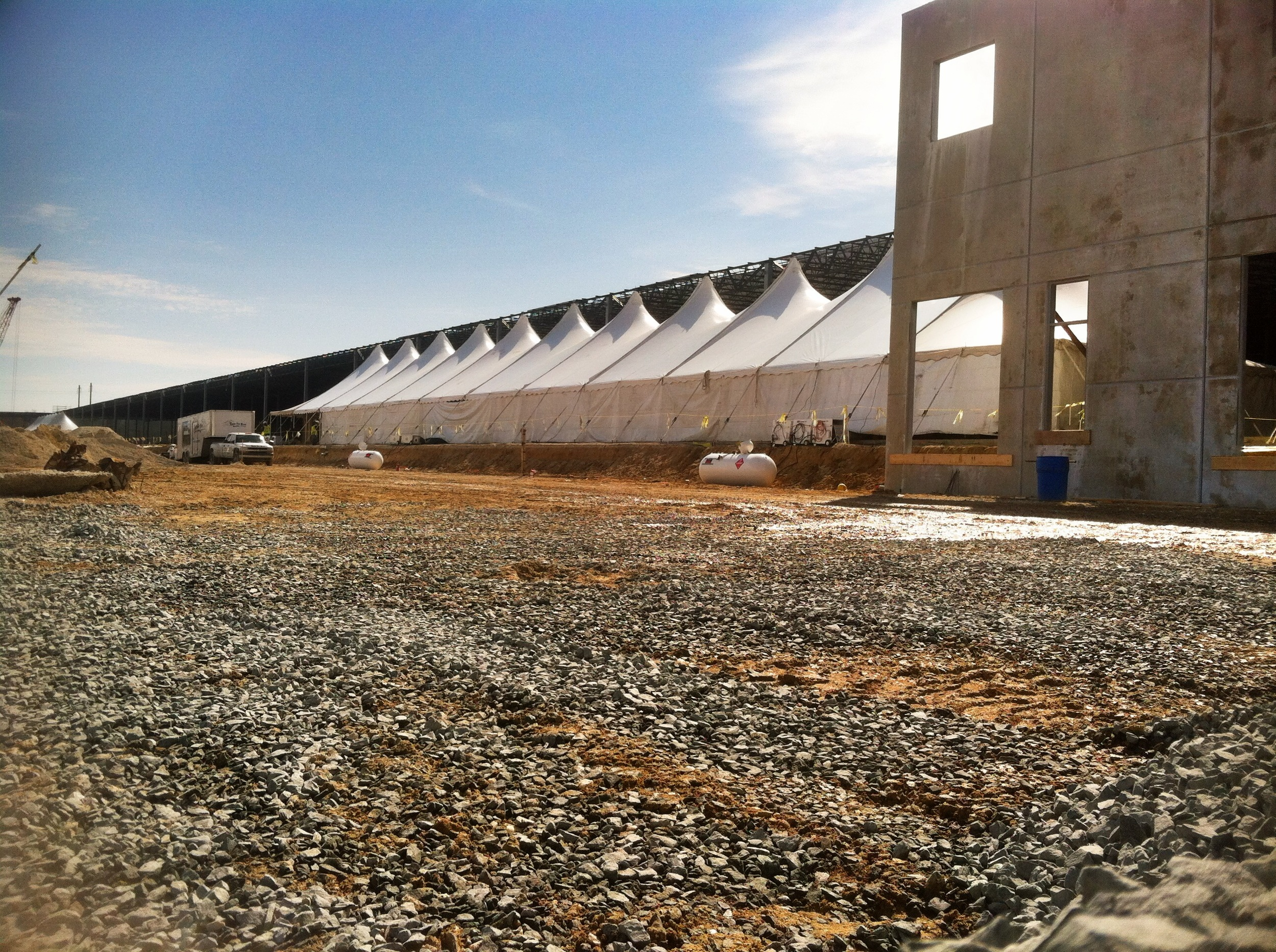 A tent keeps a winter construction project on schedule