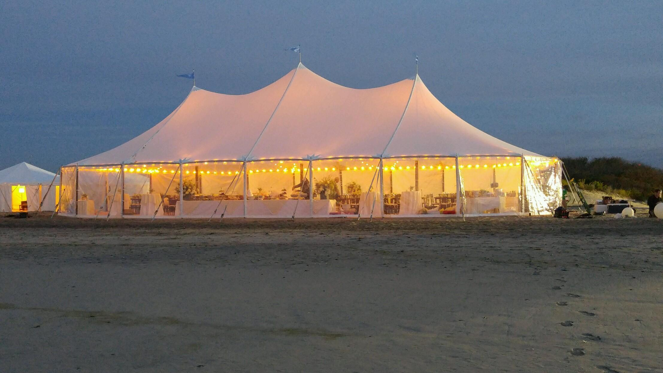 Lights on a sheer top wedding tent