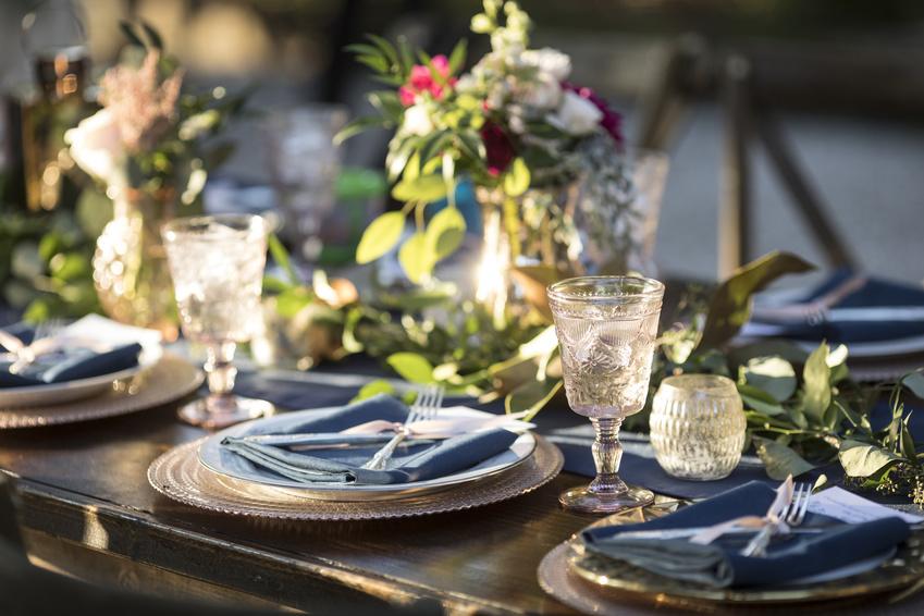 Vintage table setup for outdoor wedding reception.