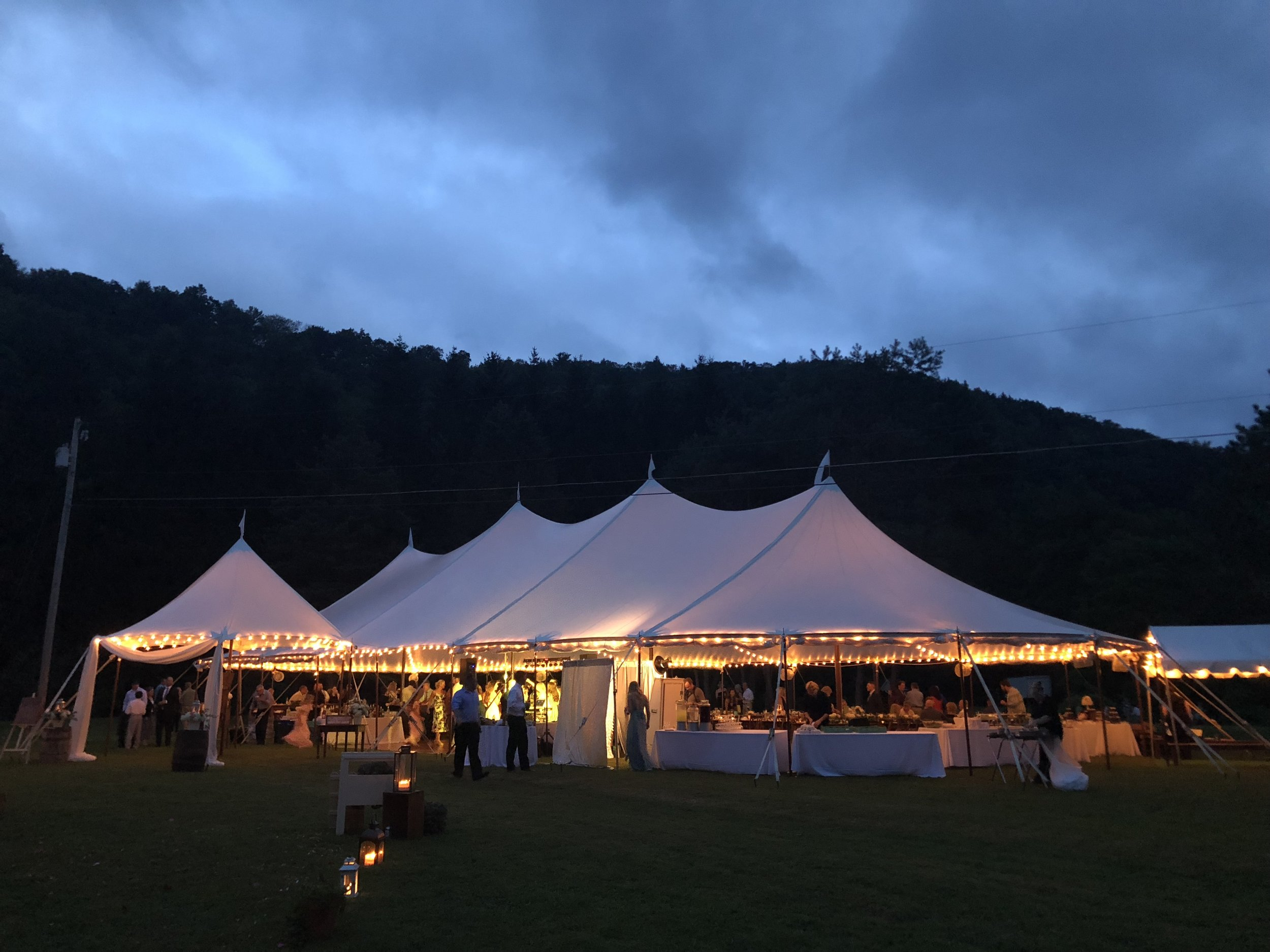 Evening romantic, rustic wedding in a sailcloth tent