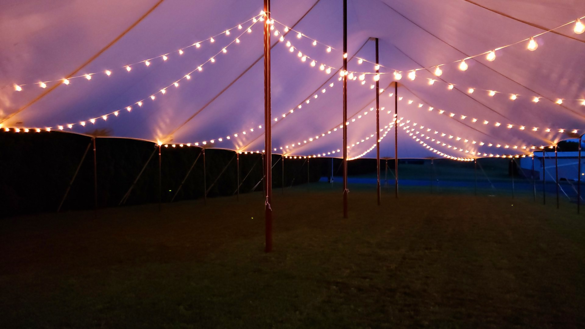 Cafe lights in a sailcloth tent