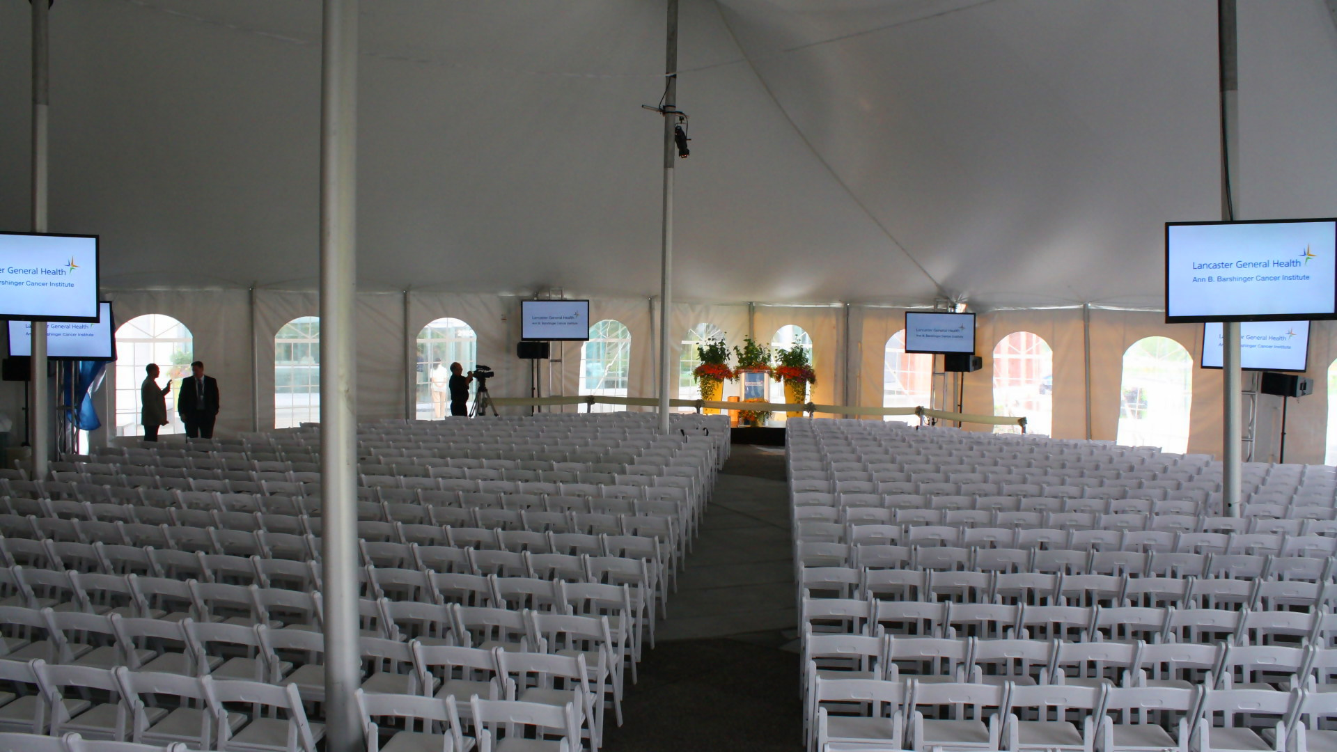 Beautiful, white tent with white chairs and cathedral window side walls