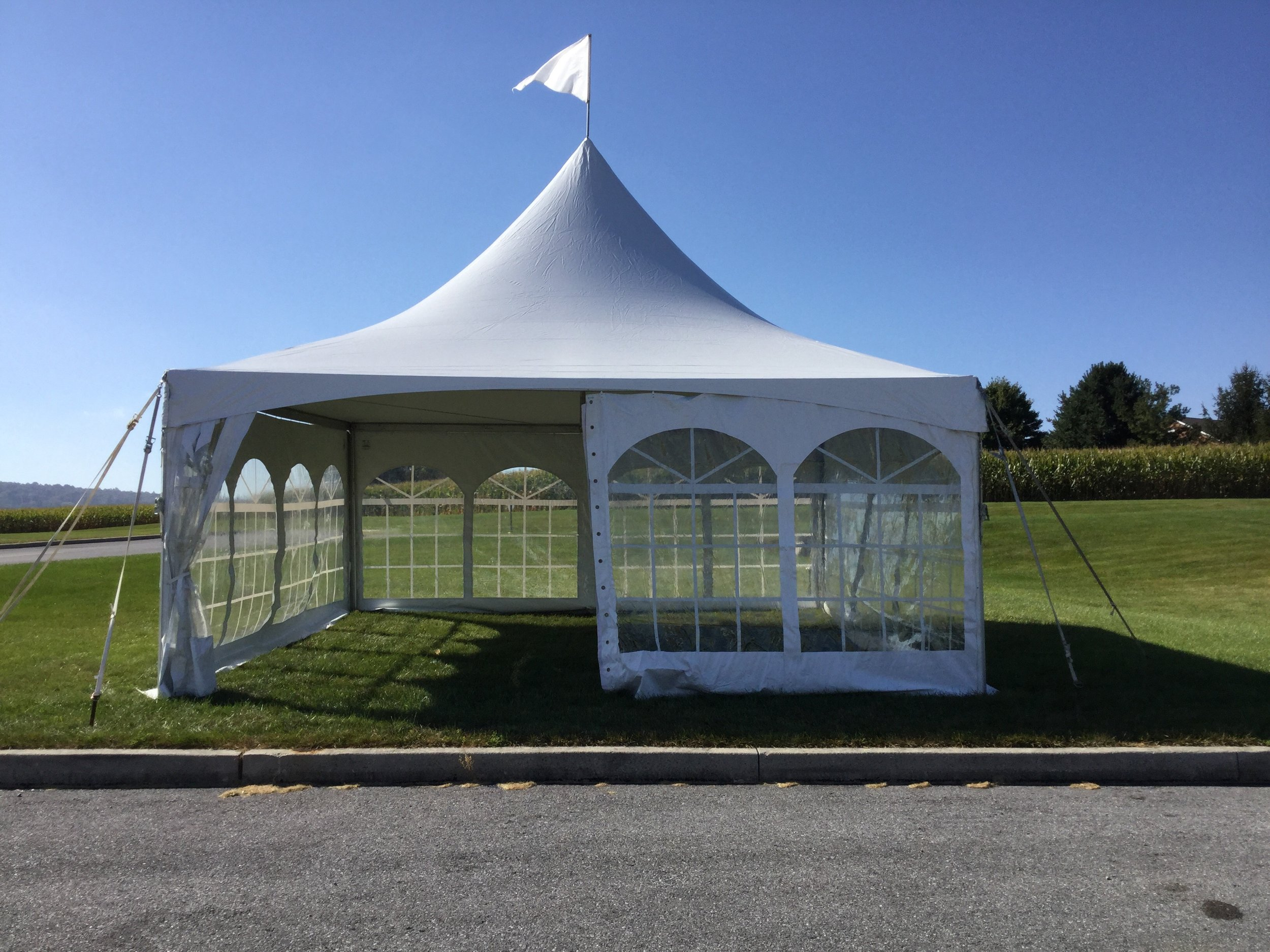 Beautiful white frame tent with cathedral window sidewalls for rent in Pine Grove, PA
