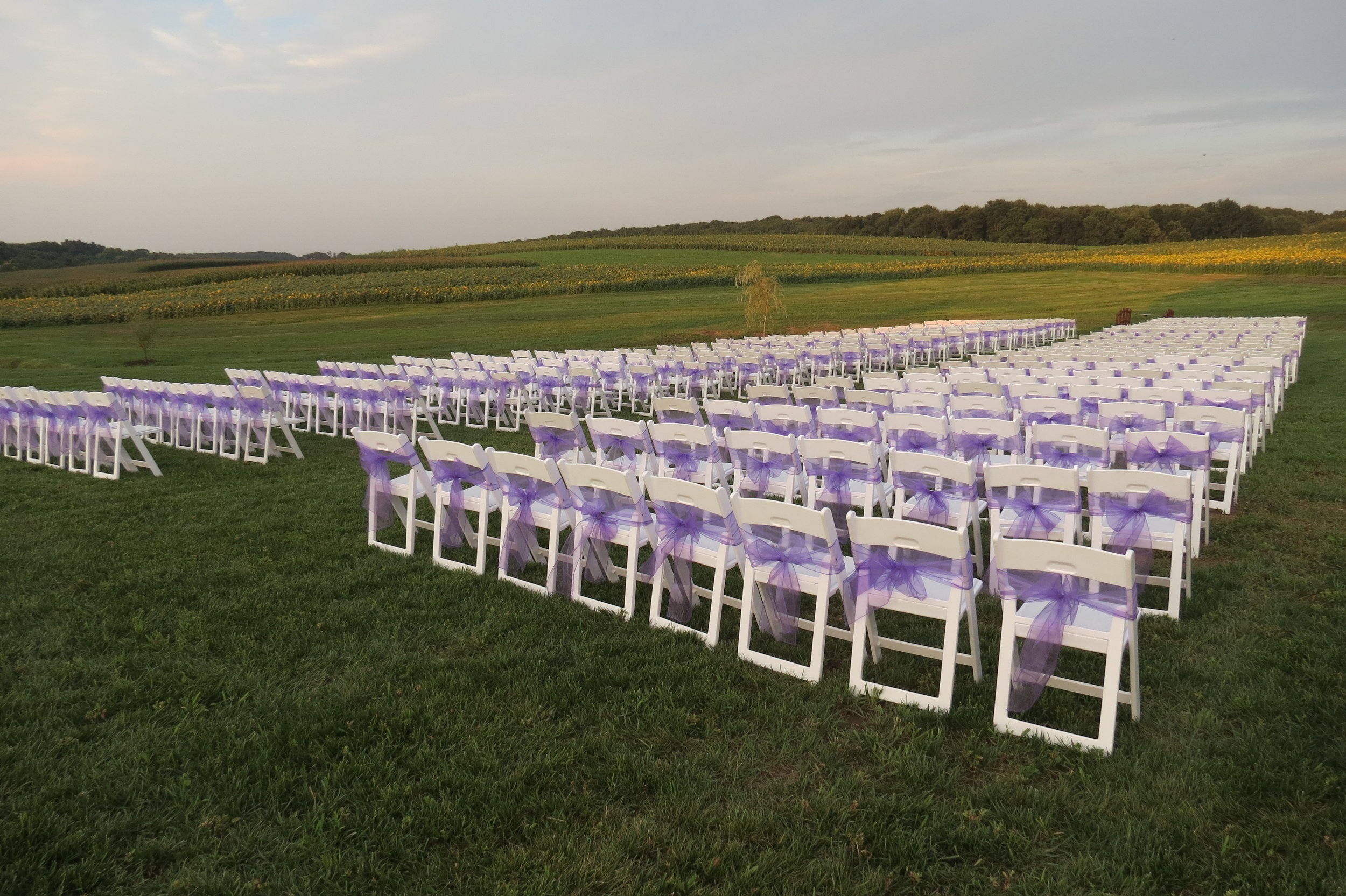 Beautiful white folding garden chairs for rent in Ocean City, MD