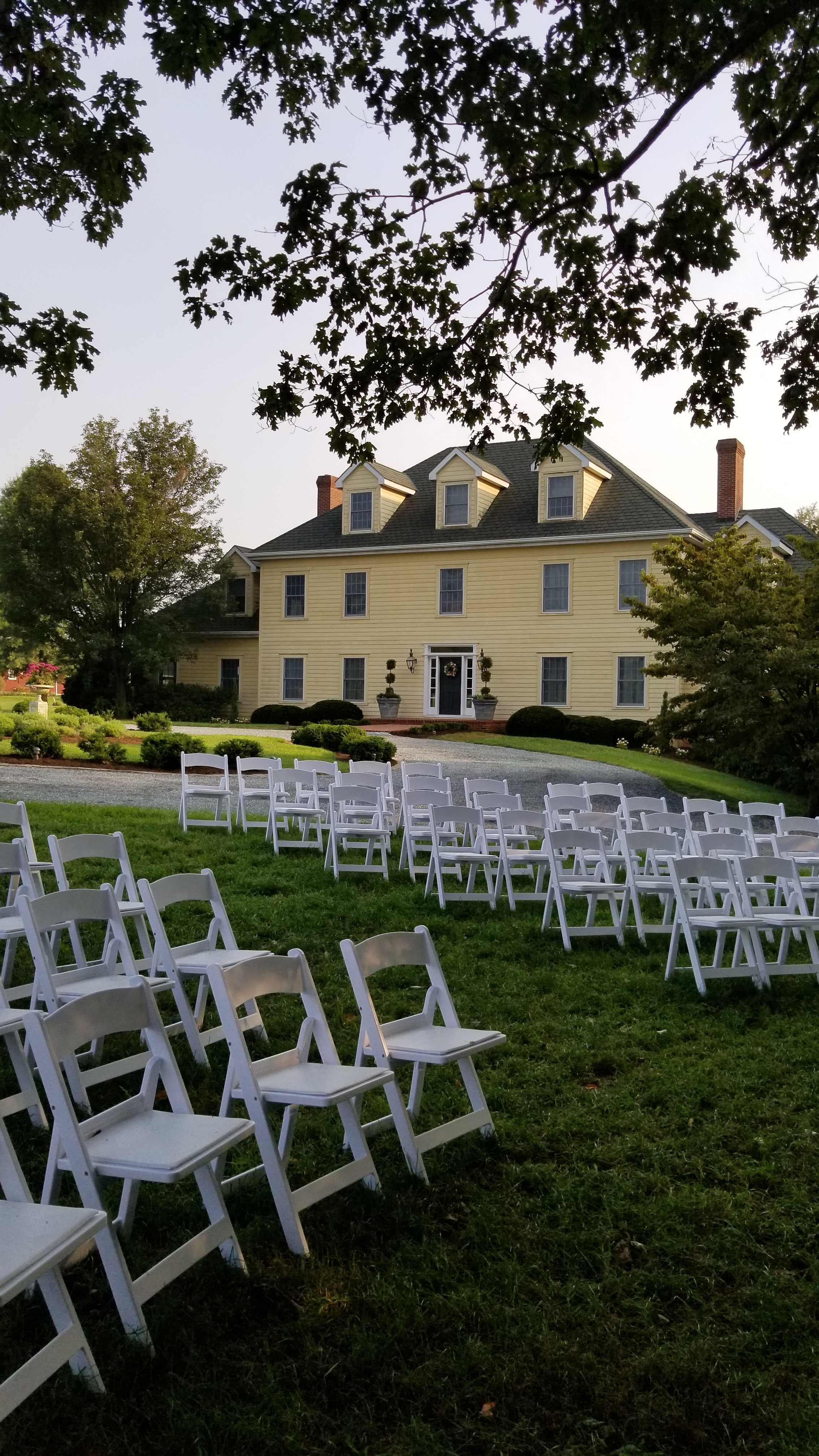 White padded chairs for outdoor wedding