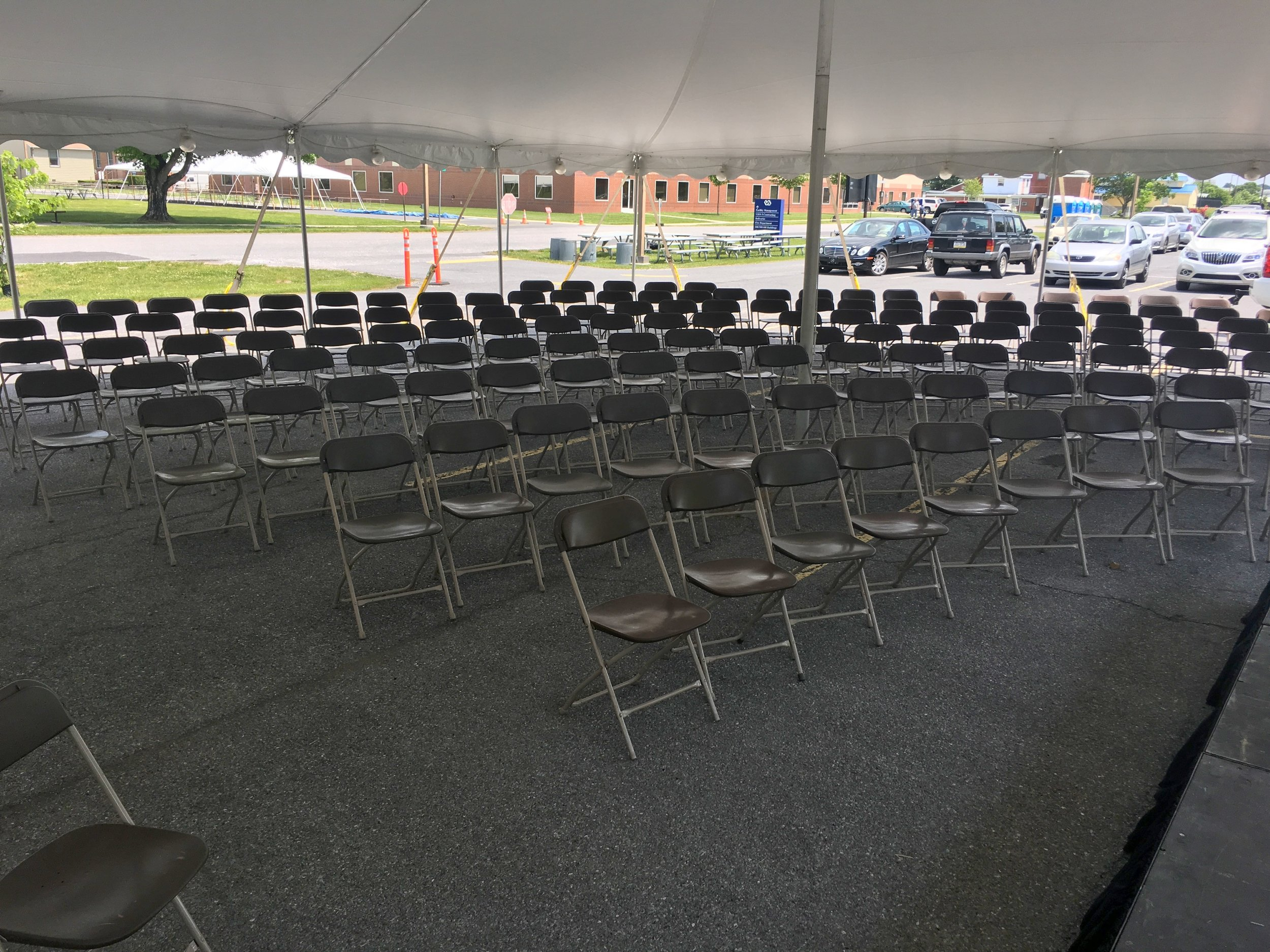 Brown folding chairs for rent for your outdoor tent events