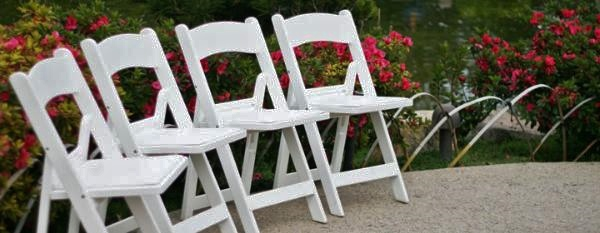 Beautiful white padded chairs to rent for your outdoor wedding